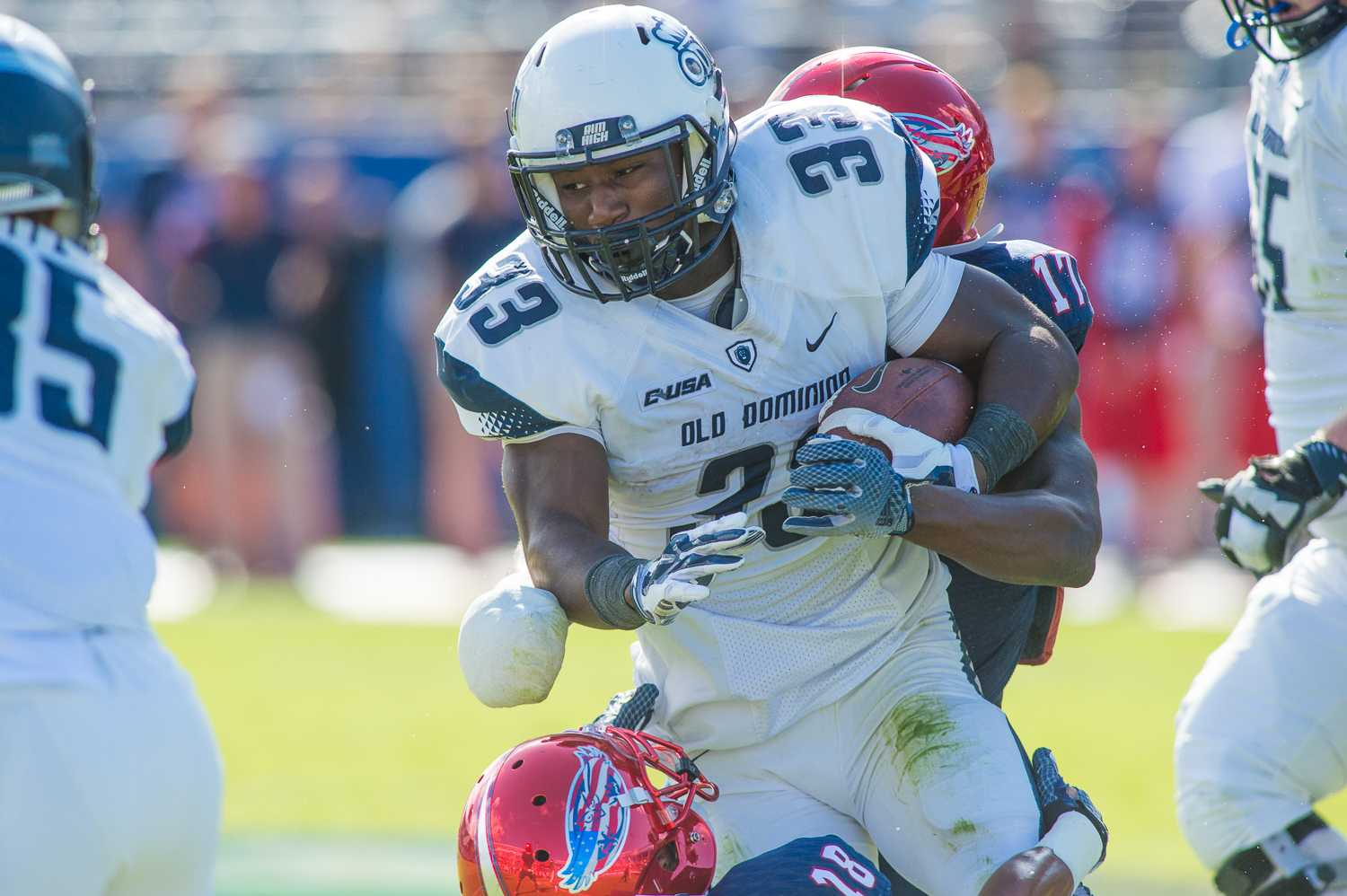 Old Dominion running back Ray Lawry tries to break free from Owls safety Damian Parms. Lawry picked up five yards on the play, and rushed for 213 yards in total.