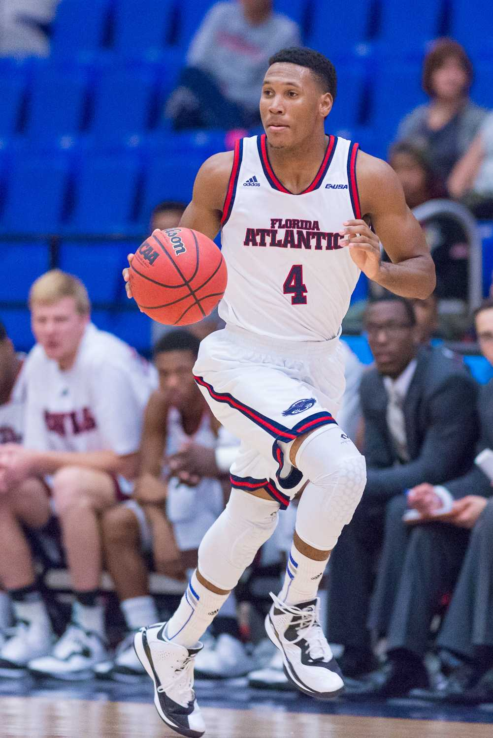 Freshman guard Justin Massey scored 17 points in the loss to Harvard on Nov. 17. Photo by Max Jackson
