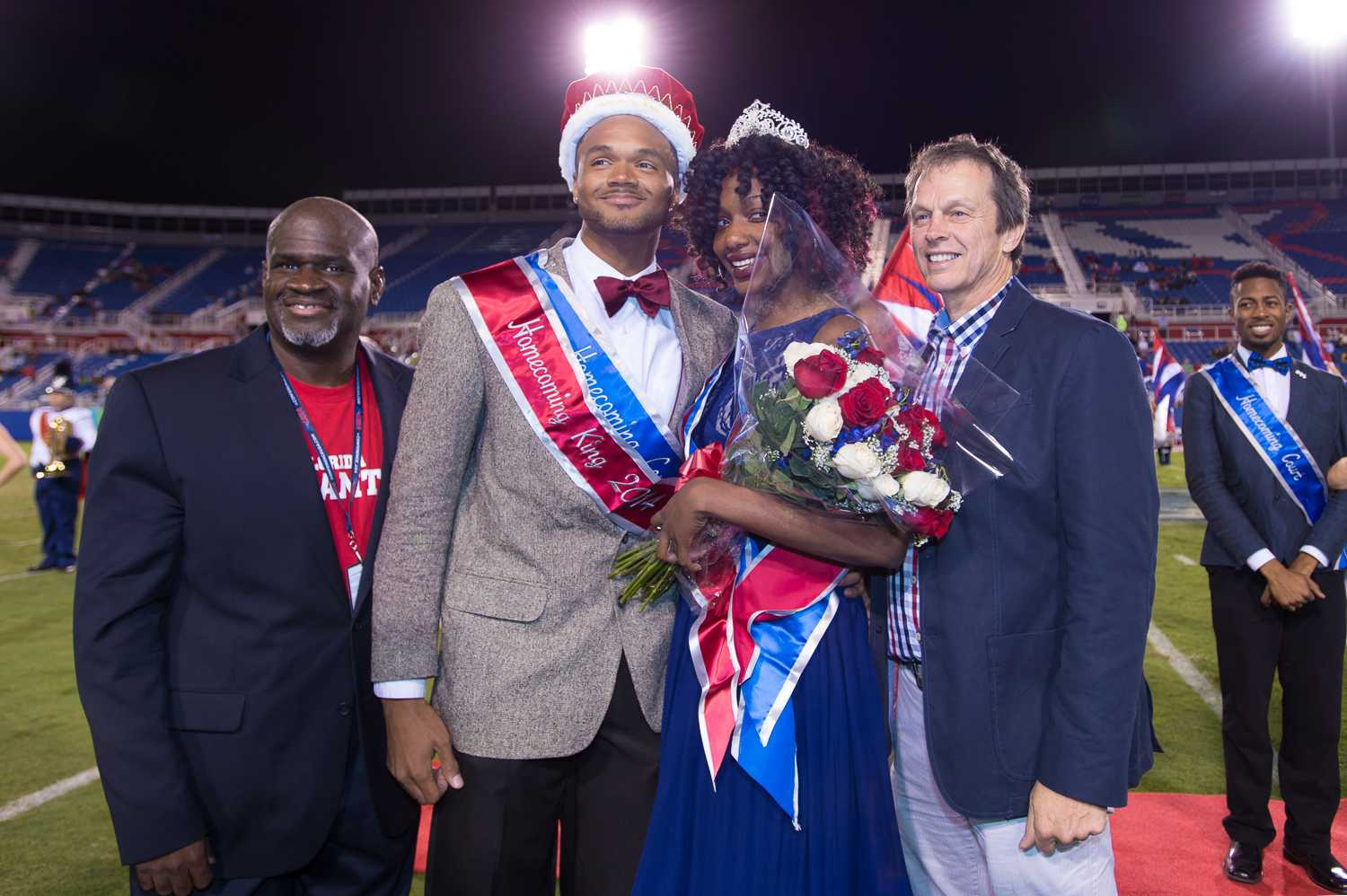 [ Max Jackson | Photo Editor ] FAU Homecoming King Byron Knight and Queen Sherrika Mitchel pose with President Kelly and Dr. King at FAU's Homecoming game against UAB.