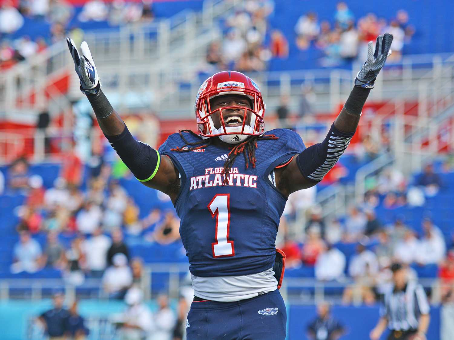 Senior wide receiver Lucky Whitehead celebrates his 73 yard punt return touchdown in the first quarter of Saturday's game.