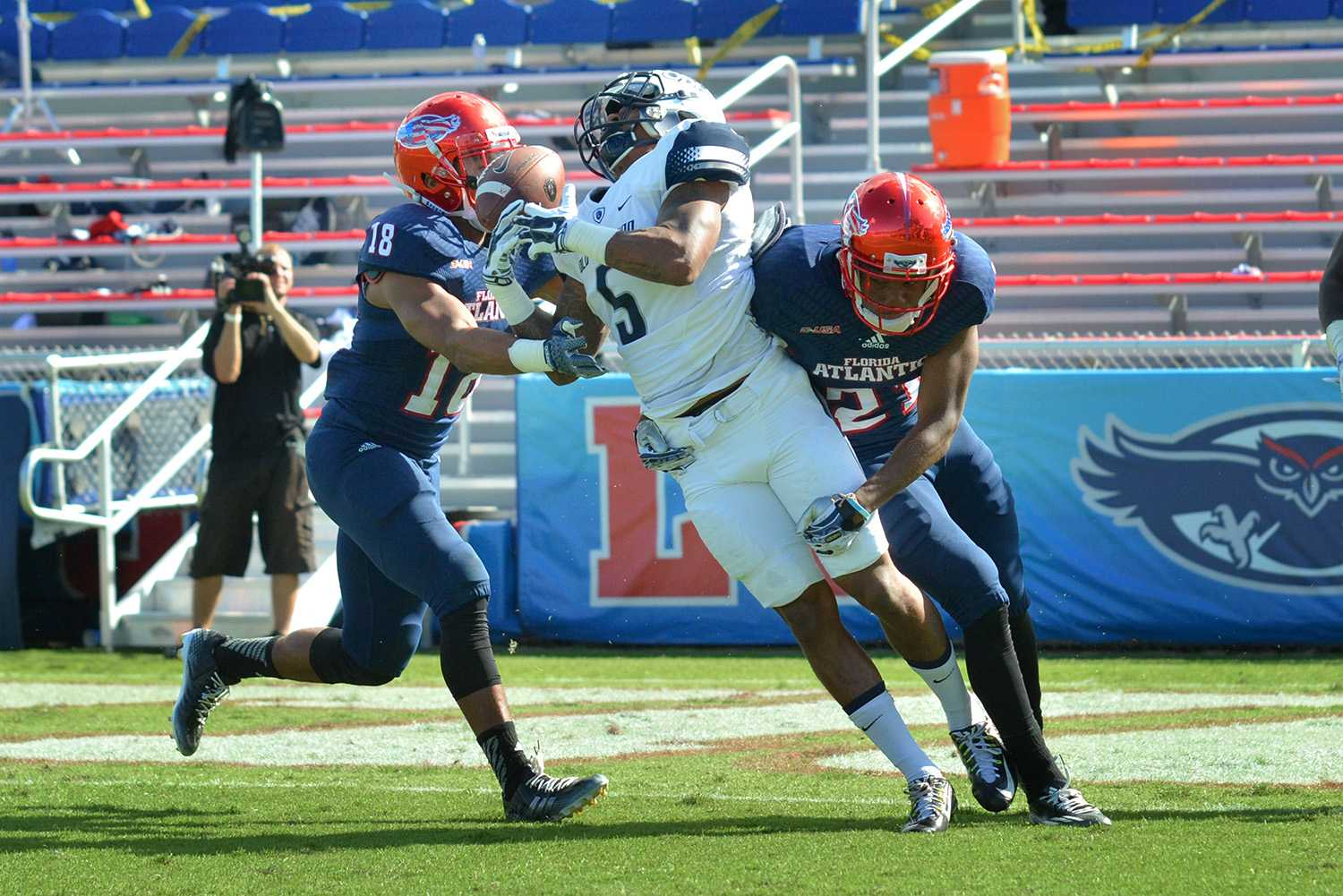 Owls senior cornerback D'Joun Smith hits Monarchs wide receiver Antonio Vaughan hard, forcing an incompletion in the second quarter during Saturday's game. Smith tallied up 5 tackles and 2 break-ups during his final game at FAU.