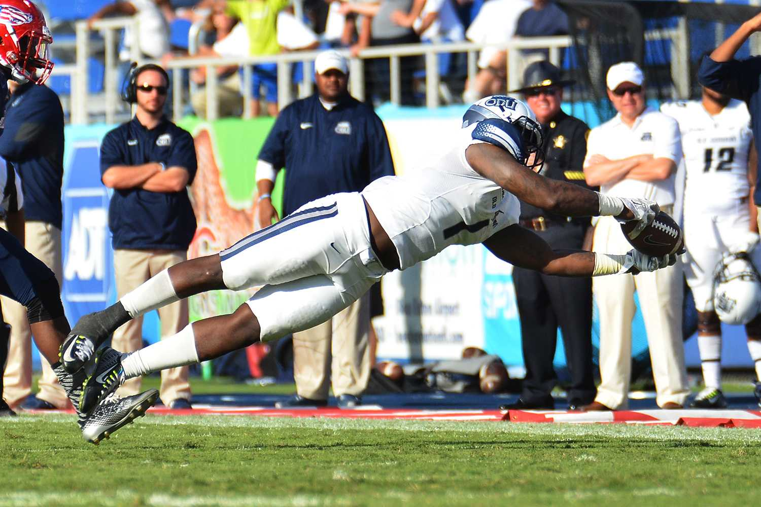 Old Dominion wide receiver Melvin Vaughn dives for a catch in the fourth quarter of Saturday's game between the Owls and Monarchs.