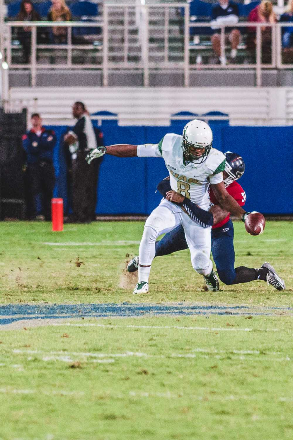 [ Gouthaman Raveendran | Contributing Photographer ] FAU defensive back Anthony Hamilton stops UAB wide receiver Nyiakki Height.