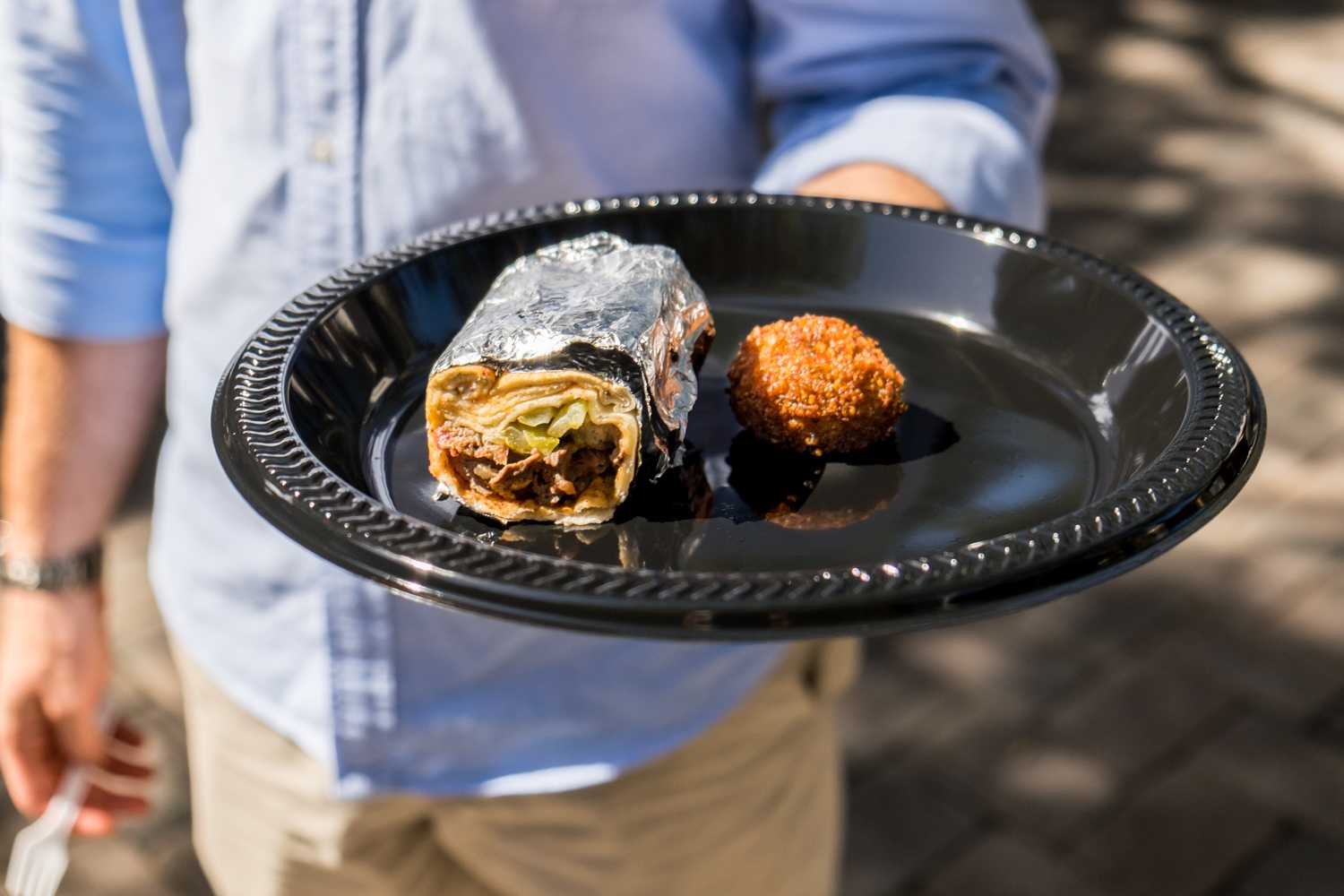 Free food was given out during Culture Fest in Tradition Plaza.  [ Mohammed F Emran | Web Editor ]