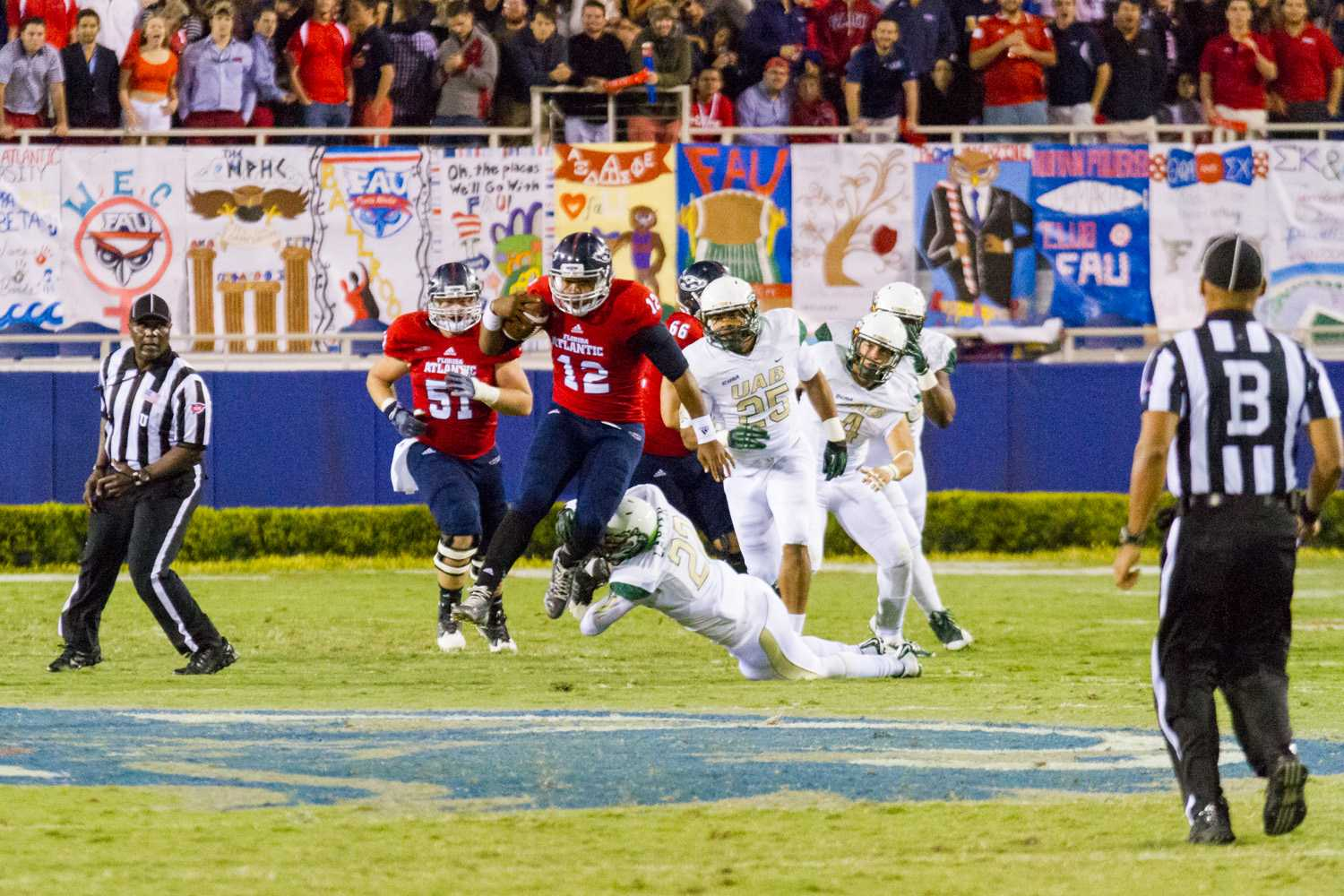 [ Mohammed F Emran | Web Editor ]  Quarterback Jaquez Johnson rushes for 18 yards to the FAU 46 for a first down.