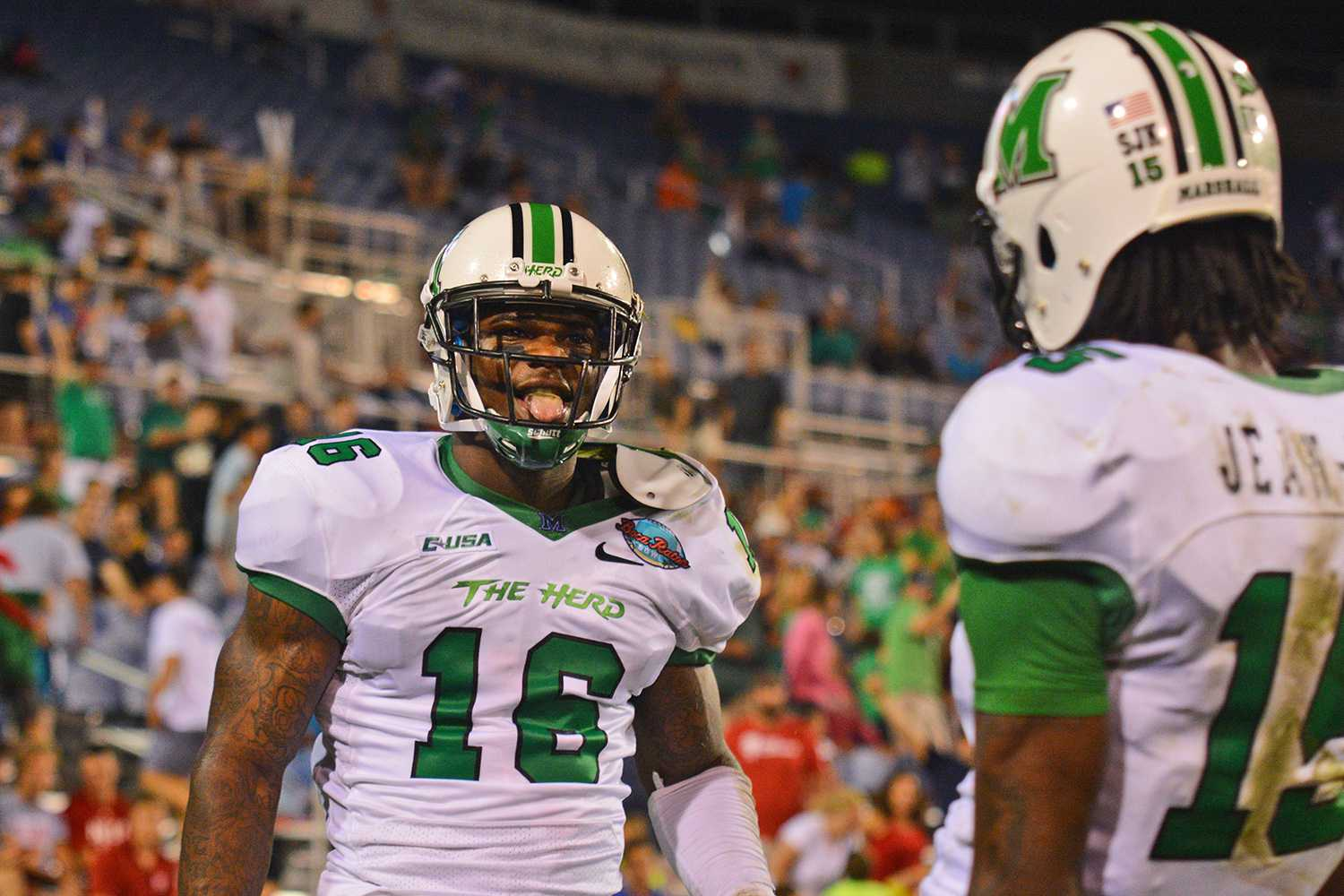 Deon-Tay McManus celebrates with Angelo Jean-Louis after he (McManus) scored a touchdown. McManus, a wide receiver from Baltimore, caught a 27-yard pass from Marshall QB Rakeem Cato, and after the extra point, the score stood at 45-20 in favor of the Thundering Herd.