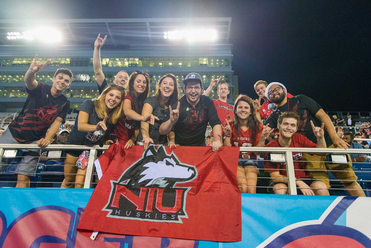 Northern Illinois Huskies fans cheer on their team in the first-ever Boca Raton Bowl on Tuesday evening, Dec 23.  The high in Dekalb on game day was 46.1 degrees, while the high in Boca Raton was 80.4 degrees.