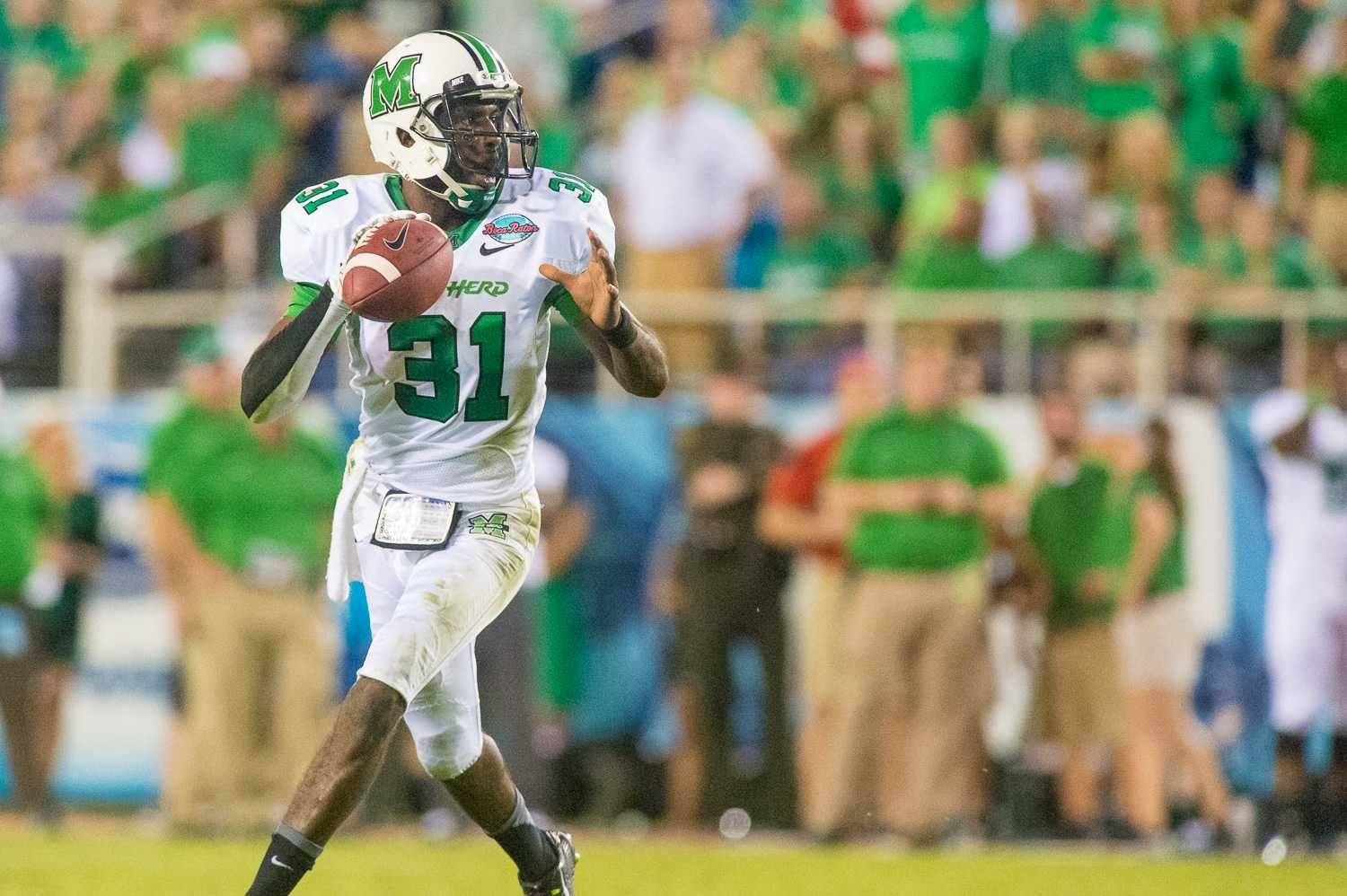 Marshall quarterback Rakeem Cato (31) looks for an open receiver in the fourth quarter of play.  Cato, wearing 31 to honor injured teammate Evan McKelvey, finished the game with 281 yards and three touchdowns.
