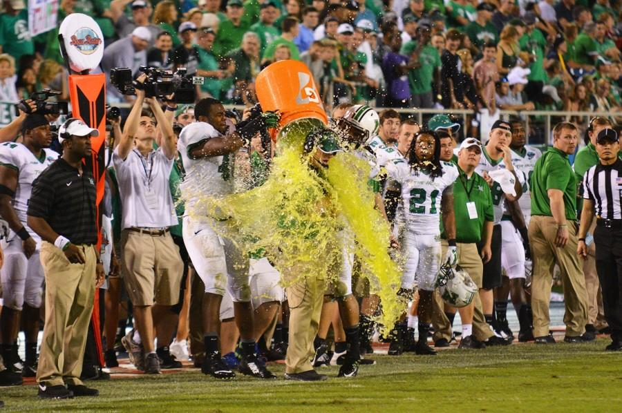Two players gave head coach Doc Holliday a traditional Gatorade bath in celebration of their 52-23 win over Northern Illinois in the first-ever Boca Raton Bowl on Dec. 23. Holliday agreed to an extension in principle with Marshall on the previous day.