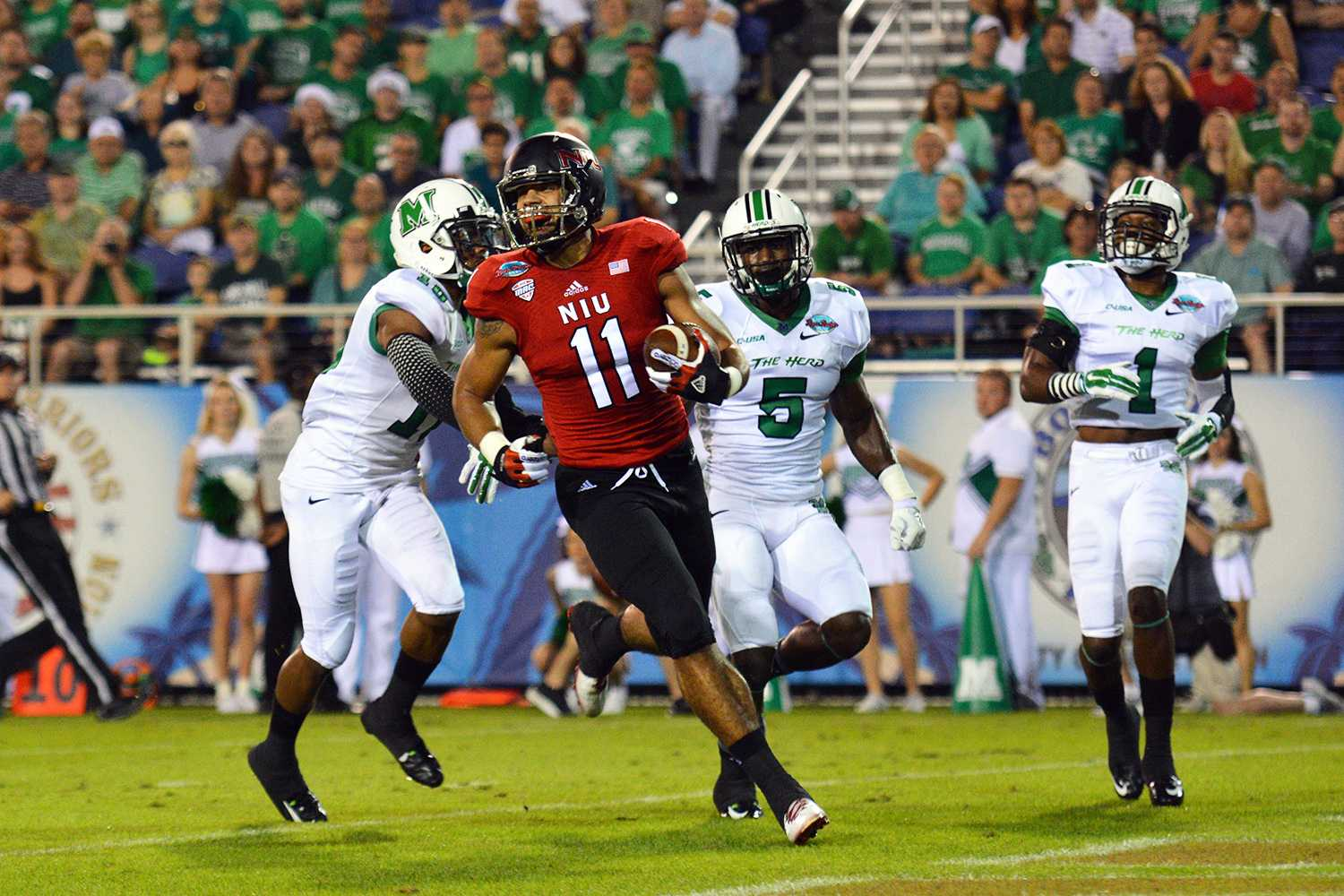 Northern Illinois University wide receiver Juwan Brescacin celebrates as he scores the first touchdown of the inaugural Boca Raton Bowl held on December 24.
