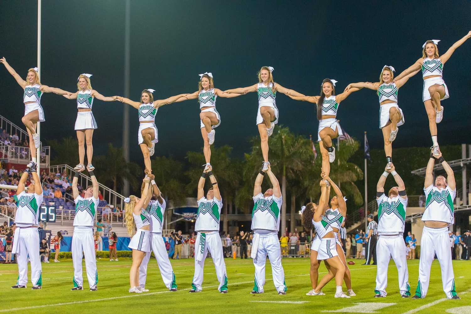 Marshall cheerleaders perform during a pause in play.