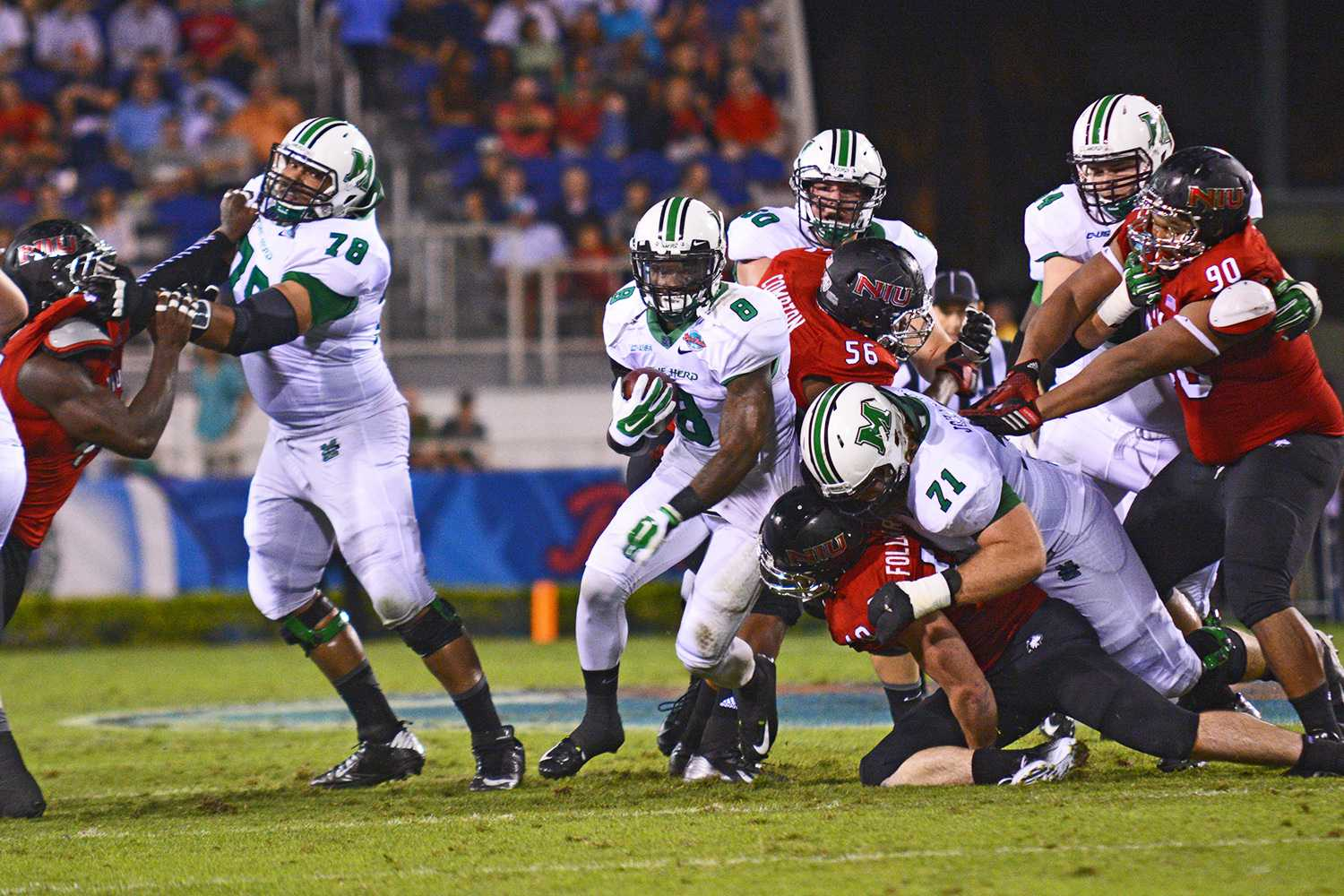 Marshall running back Remi Watson knifes through a gap for what became a 25-yard gain.