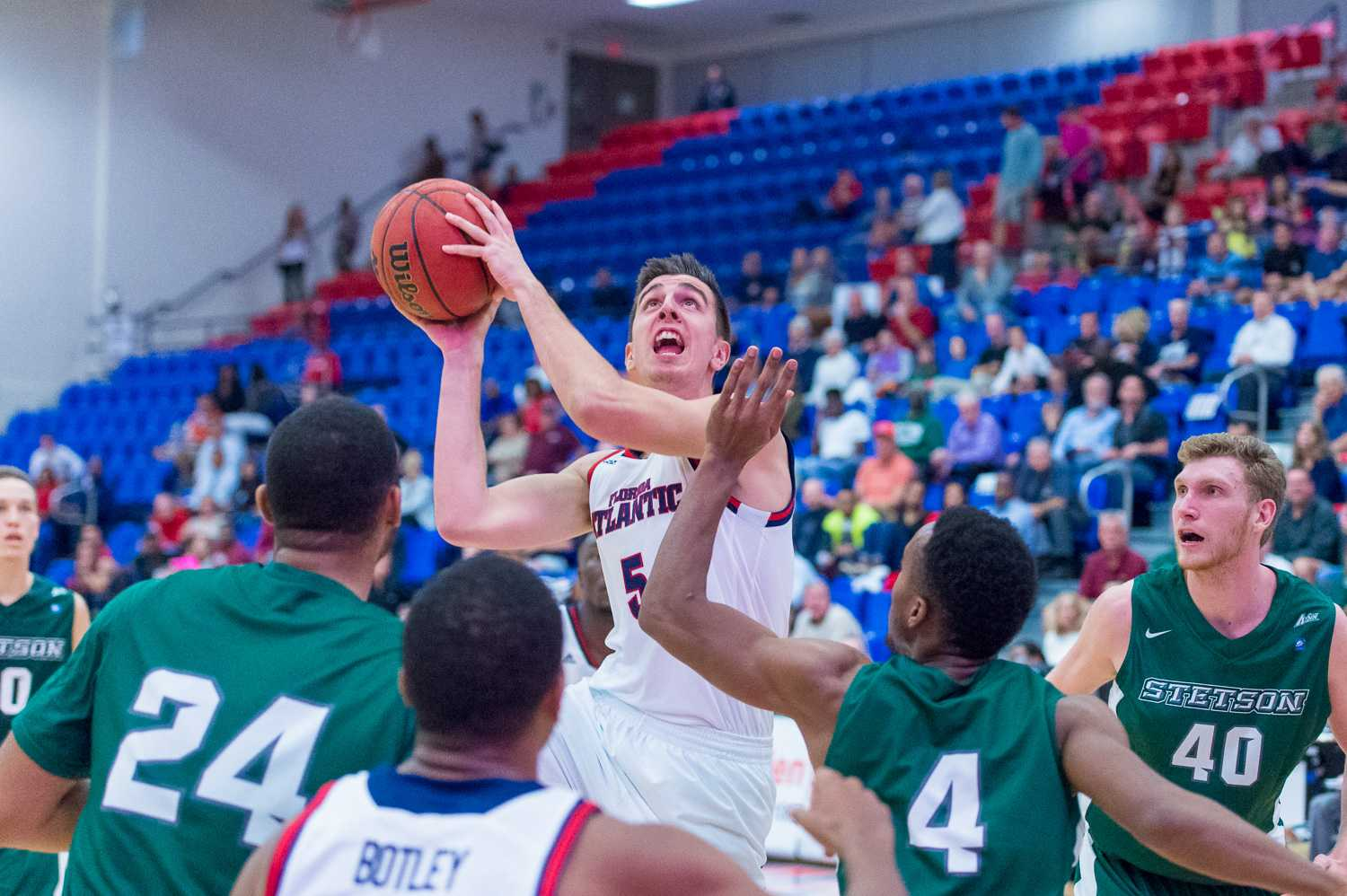 FAU forward Javier Lacunza draws a foul late in the first half against the Stetson Hatters.