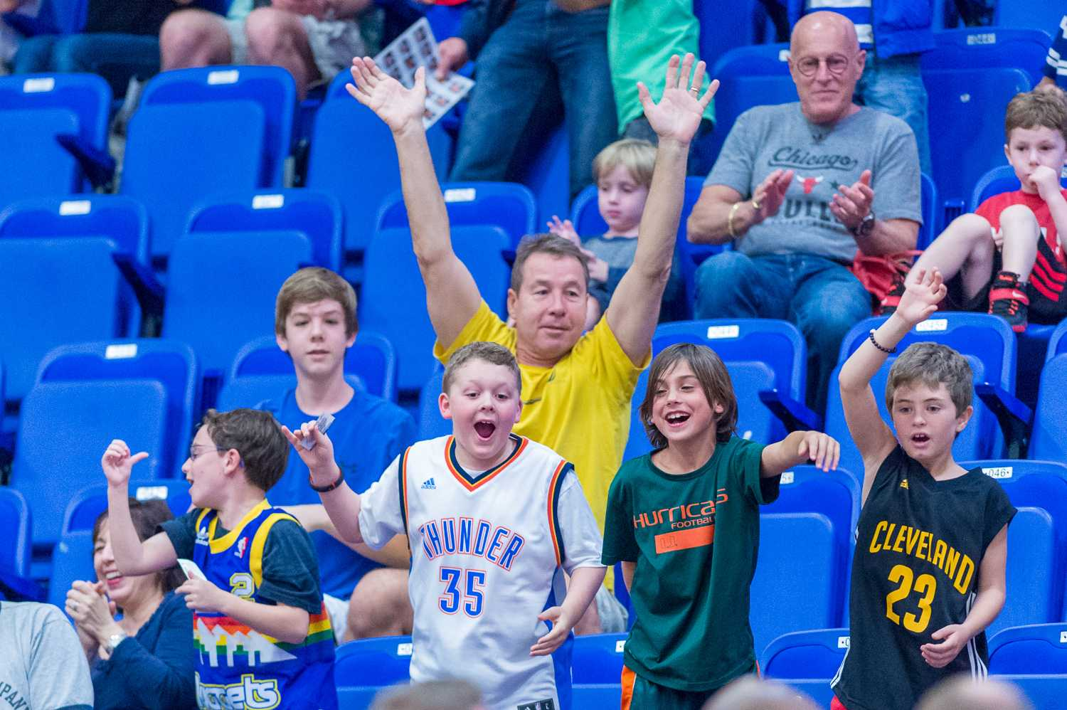 Young Owls fans yell for a t-shirt during a timeout in the first half of the FAU v. EKU matchup.