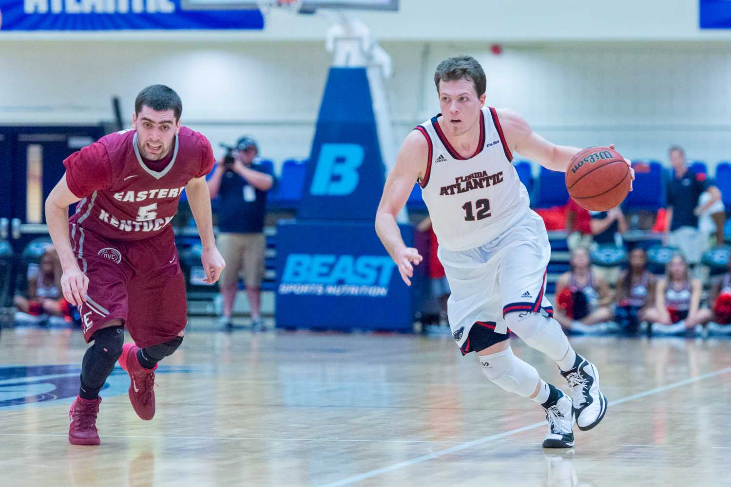 Guard Jackson Trapp looks for a teammate as he dribbles up the court.  Trapp led his team with 19 total points.