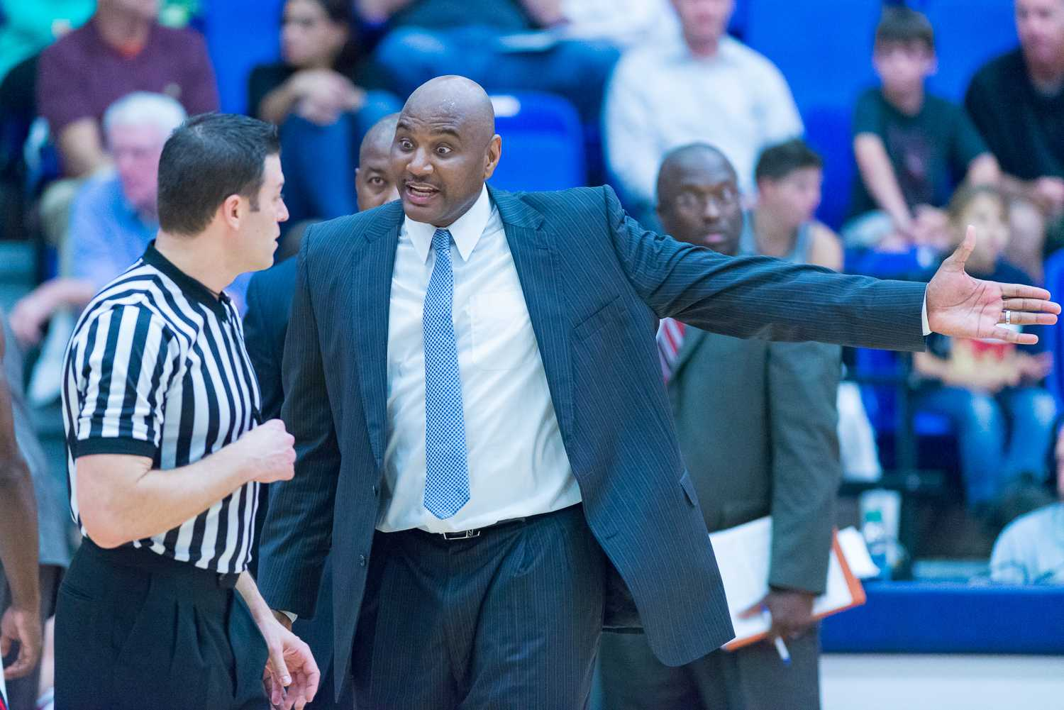 FAU head coach Michael Curry argues with a referee over a call in the second half.