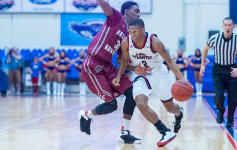 Owl guard Marquan Botley charges towards the basket  past EKU guard Ja'Mill Powell.  Botley scored 15 points against the Colonels. Photo by Max Jackson