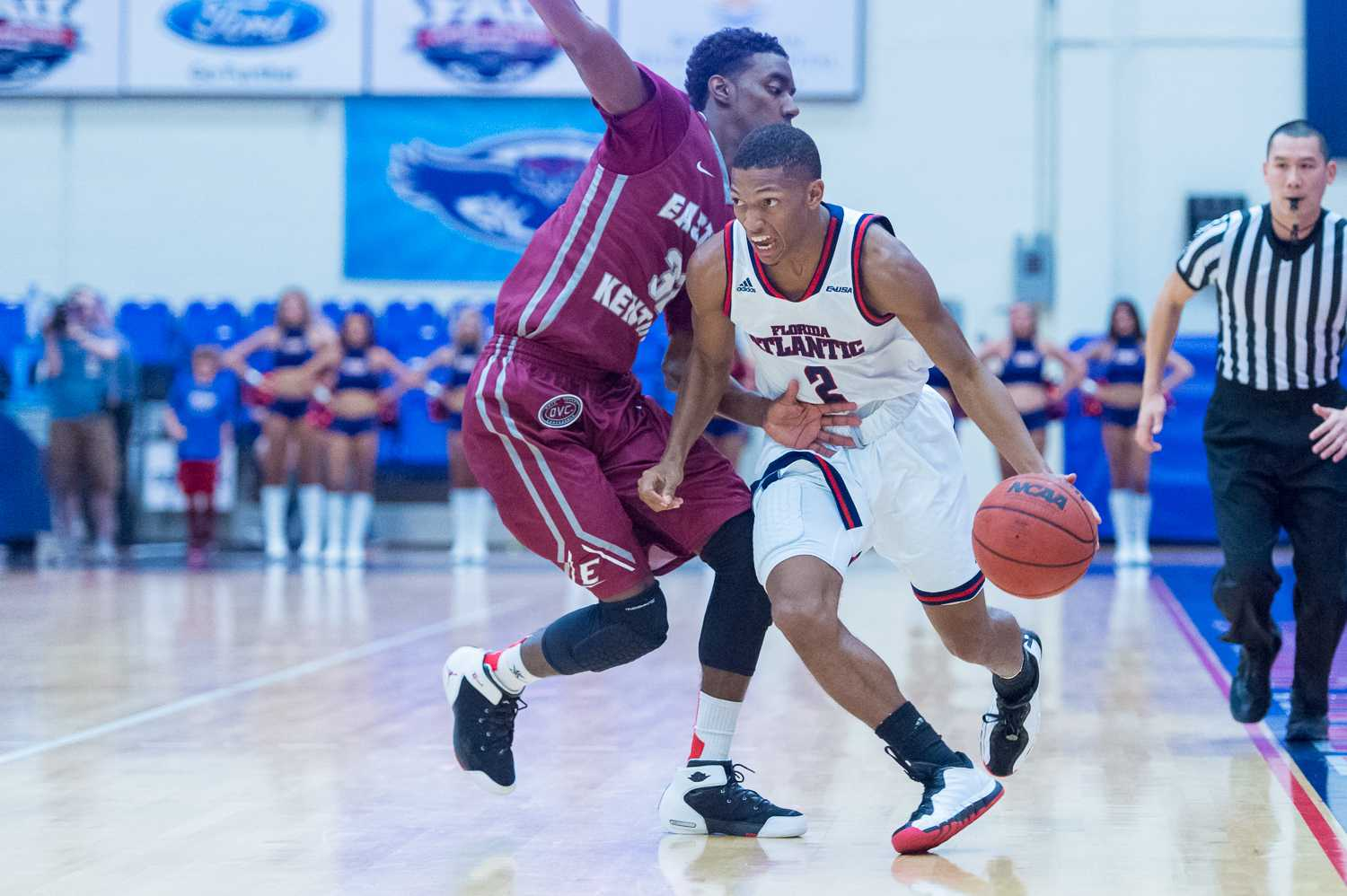 Owl guard Marquan Botley charges towards the basket  past EKU guard Ja'Mill Powell.  Botley scored 15 points against the Colonels.