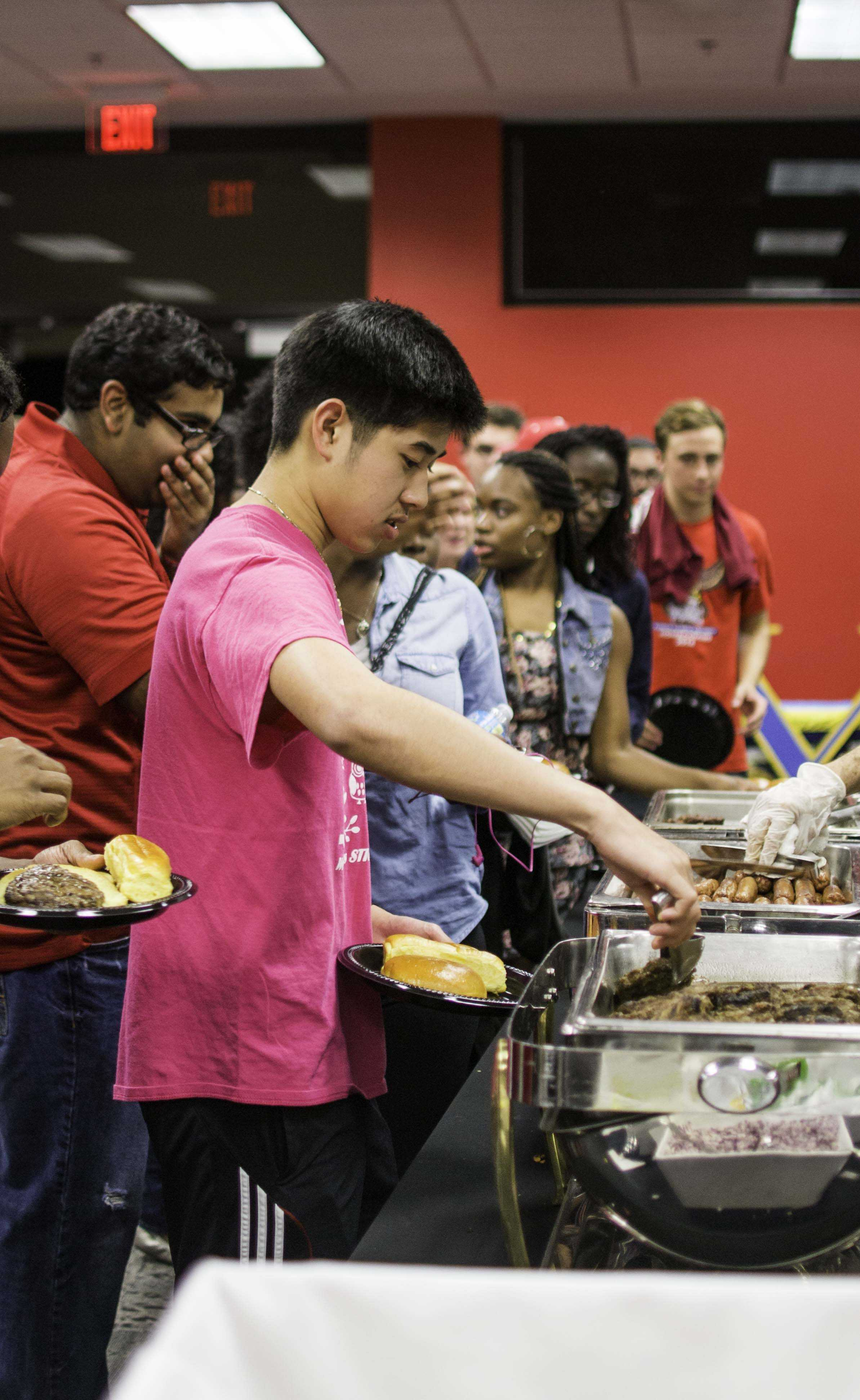 FAU students grabbing food at the Grilling with the Greeks event.