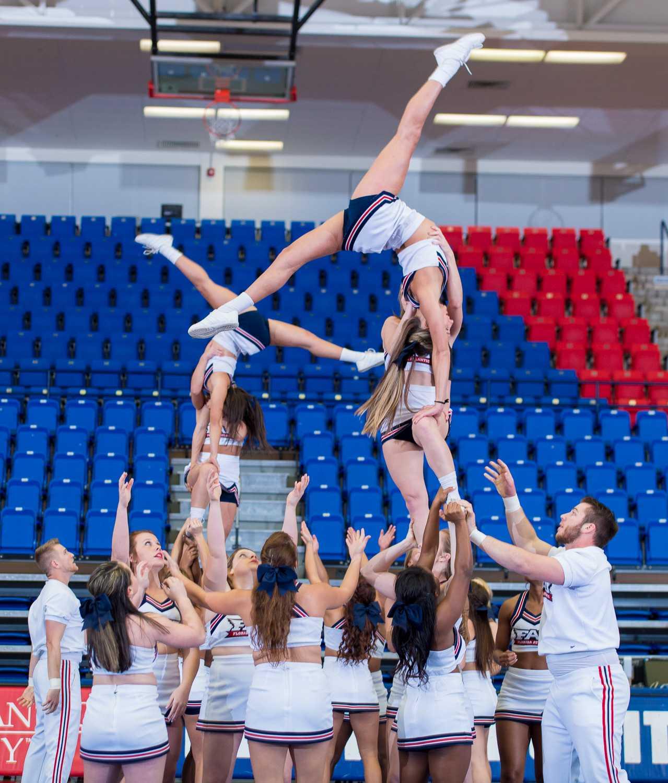 The FAU Cheerleaders show off a pyramid at the 2015 FAU Dance Team Showcase in The Burrow.