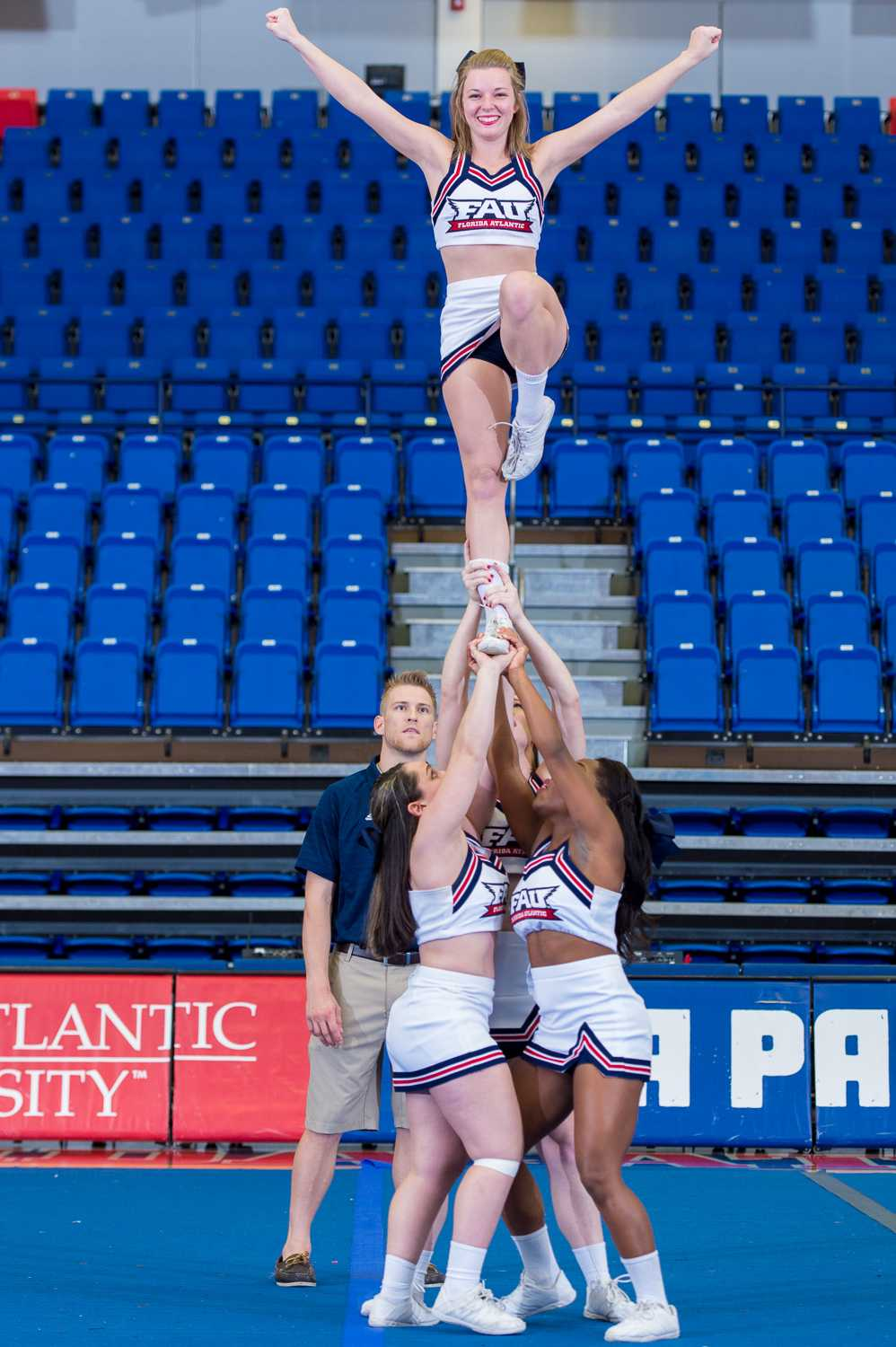 FAU Cheerleaders Marisa Paglino (left), Amanda Johnson (back),  Colette Bienvenu( right) and Kelsey Miller (top) pull a Liberty at the 2015 FAU Dance Team Showcase in The Burrow.