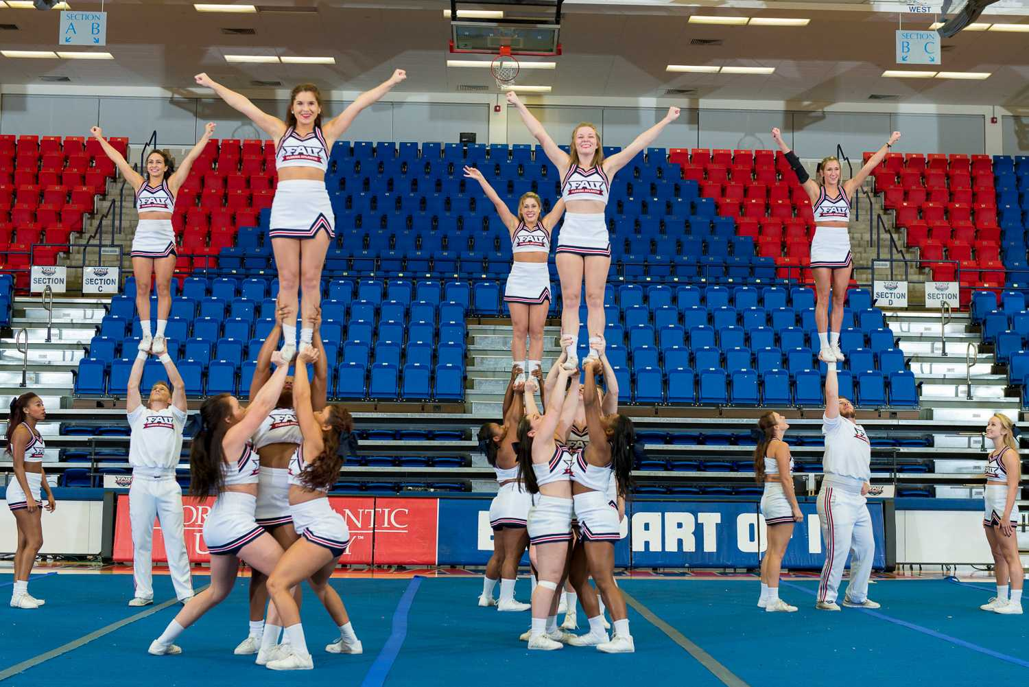 FAU Cheerleaders perform an extension ( left four) and a cupie (right) at the 2015 FAU Dance Team Showcase.