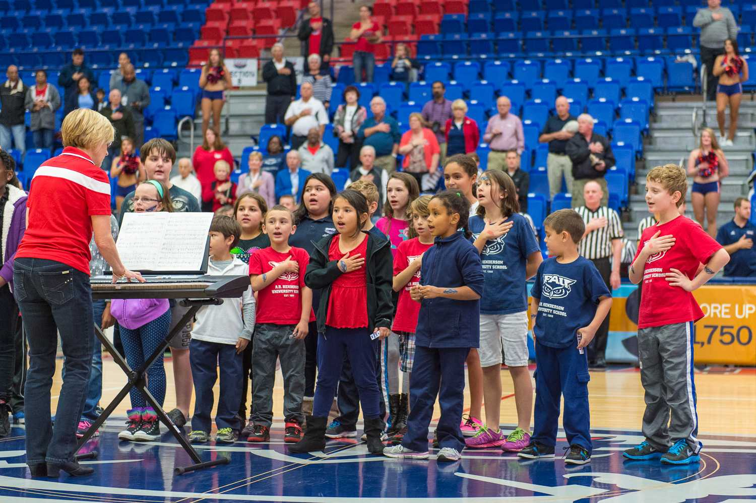 Students from A.D Henderson Elementary School sing the National Anthem prior to the start of FAU Women's Basketballs game against the Charlotte 49ers.