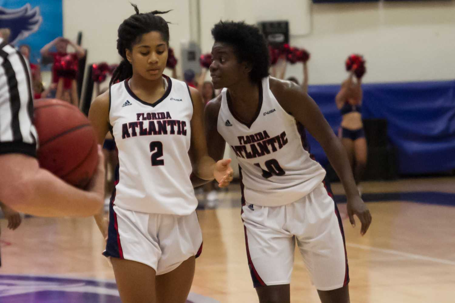 Morgan Robinson motivates teammate Shaneese Bailey (2) before a free throw late in the second half.