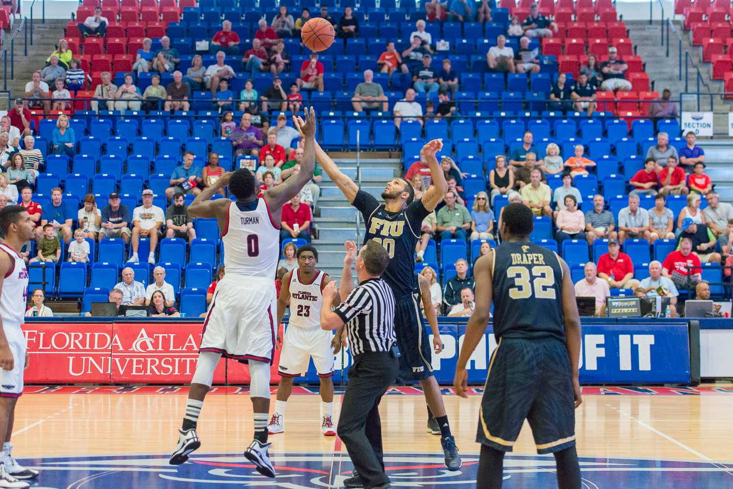 Owl's forward C.J. Turman (0) and FIU forward Adrian Diaz jump for the ball to begin their first match-up of the season.