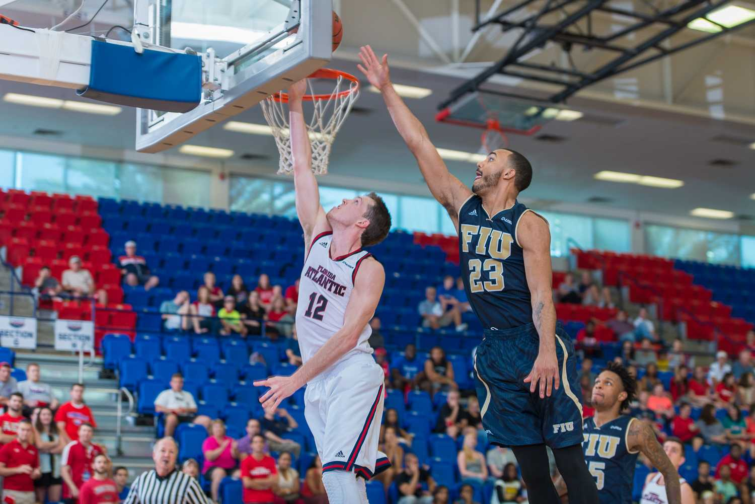 Guard Jackson Trapp (12) scores a layup in the tenth minute of the first half to narrow FIU's lead to six, 10-16.