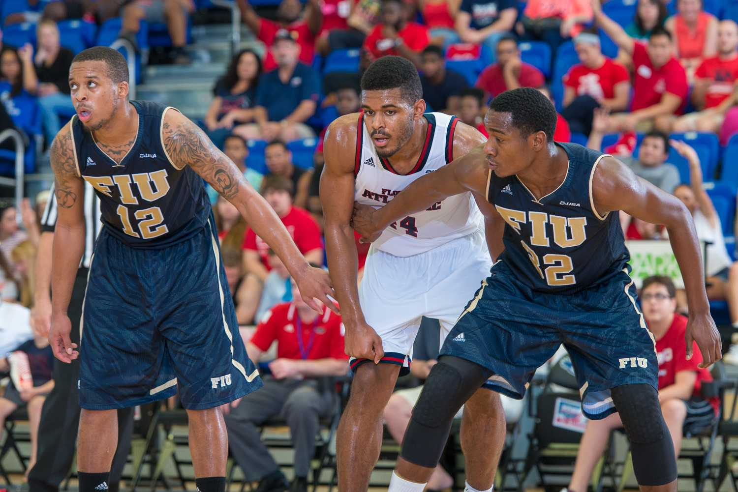 Owl's forward Kelvin Penn (44), lines up with FIU forward Daviyon Draper (32) and guard Dominique Williams (12) during an FAU free throw in the second half.