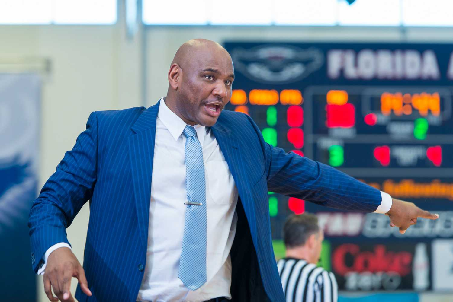 FAU head coach Michael Curry directs one of his players in the second half of play.