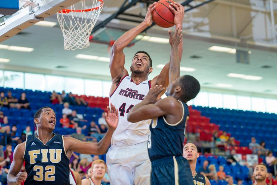 FAU forward Kelvin (44) Penn grabs a rebound as Panthers center Michael Phillip attempts to gain possession.