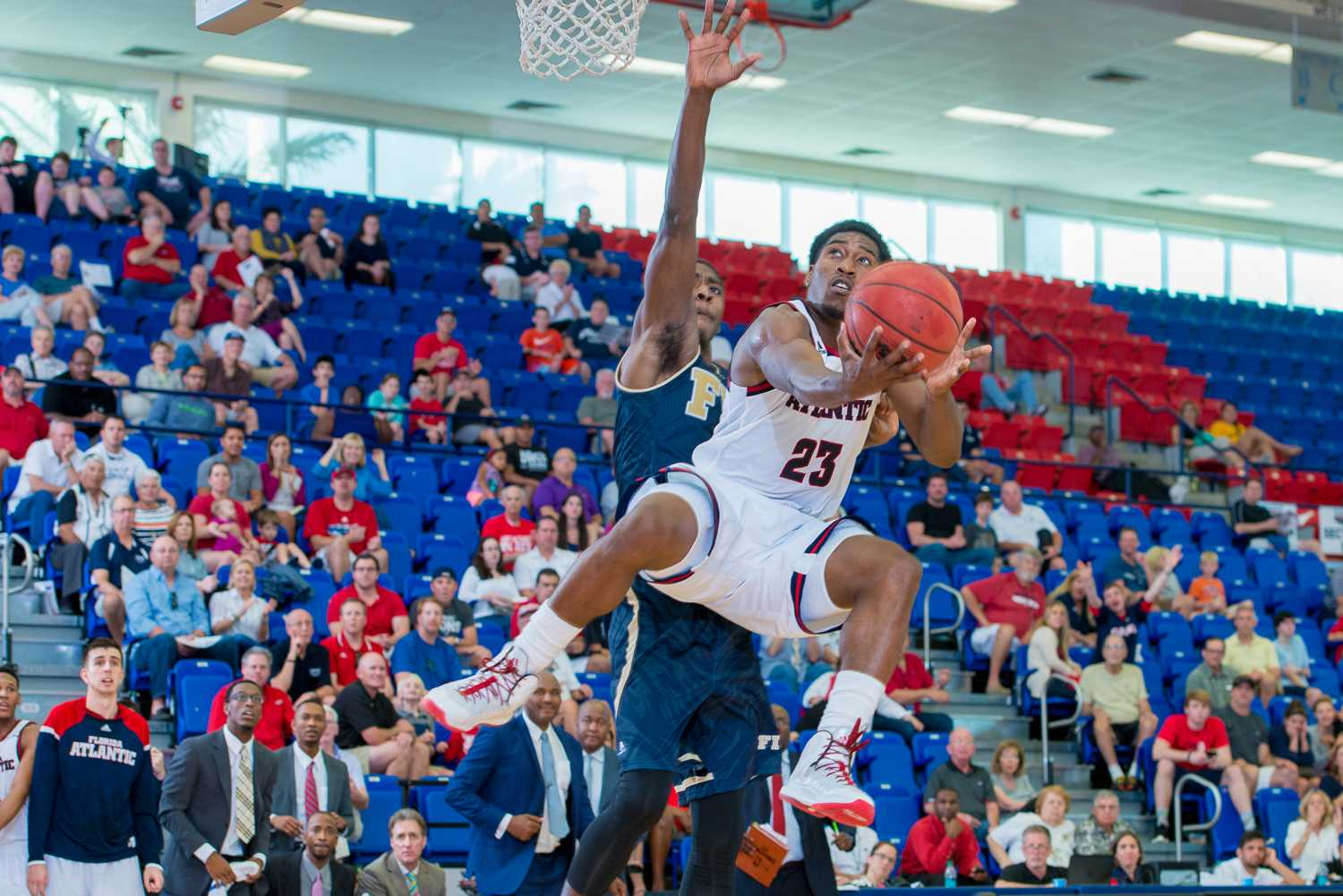 Solomon Poole shoots a successful layup in the second half against the Golden Panthers.