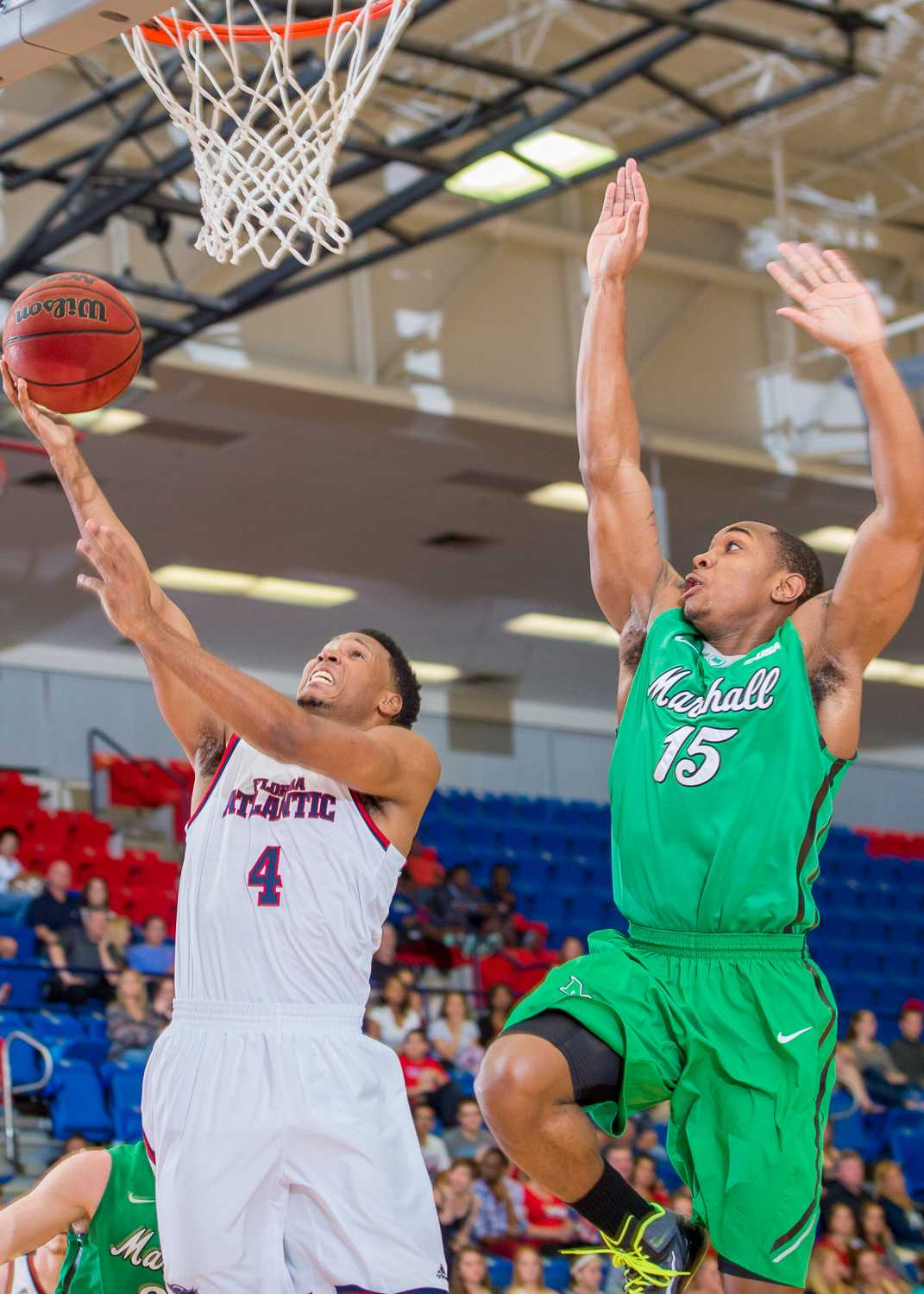 Massey (4) attempts a layup after FAU's defense stole the ball from Marshall.  Massey scored five points on the day.