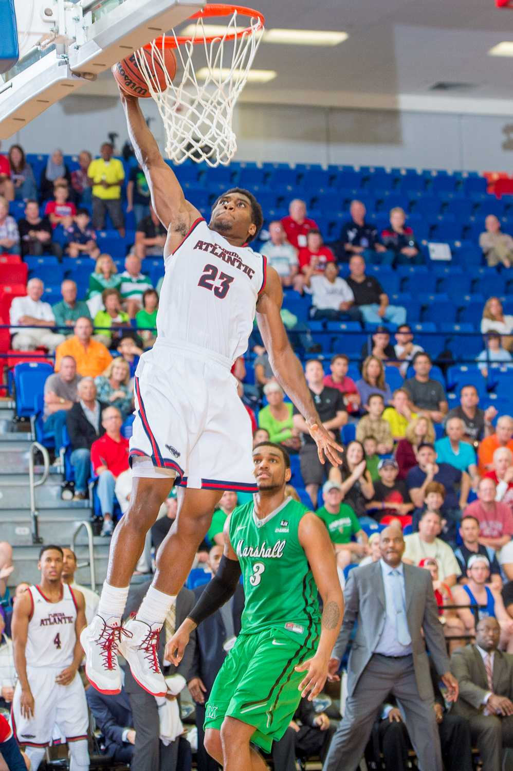 Solomon Poole (23) attempts a dunk to widen the Owl's lead in the second half.