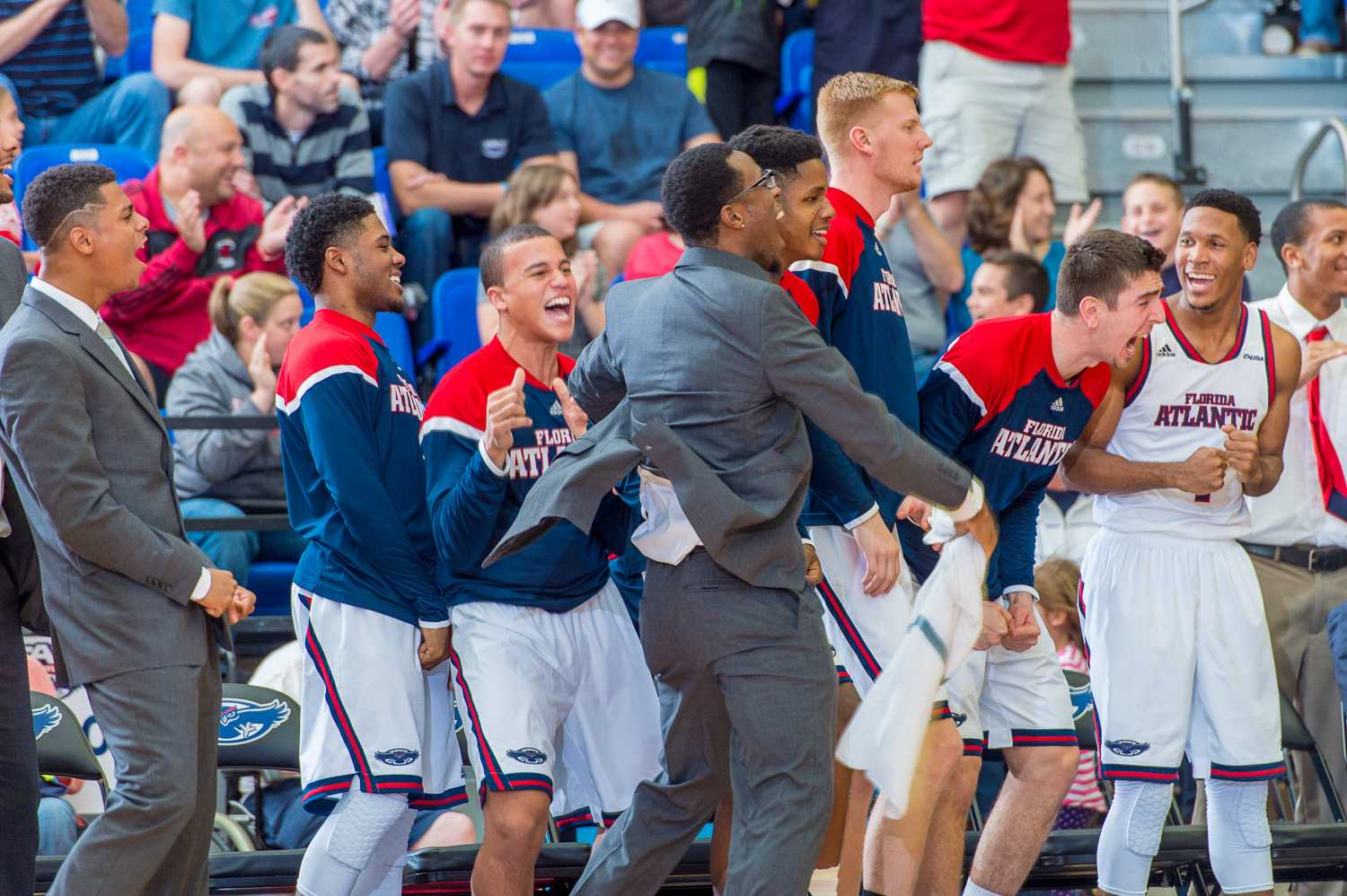 The FAU bench jumps up and cheers after their first conference win over Marshall is secured.