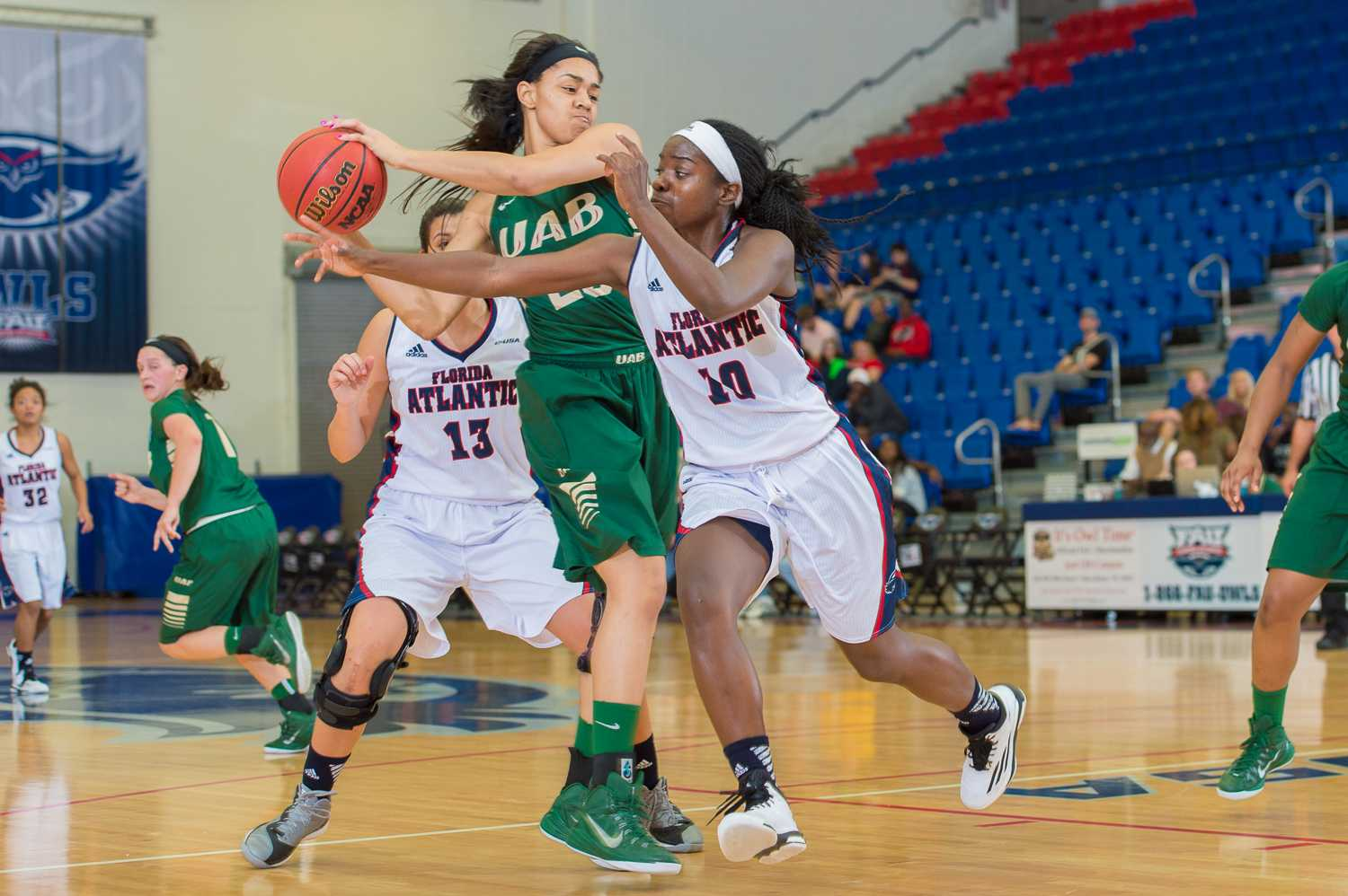 UAB forward Kayla Anderson (23) grabs a rebound in the second half while FAU guard Morgan Robinson (10) attempts to gain possession.