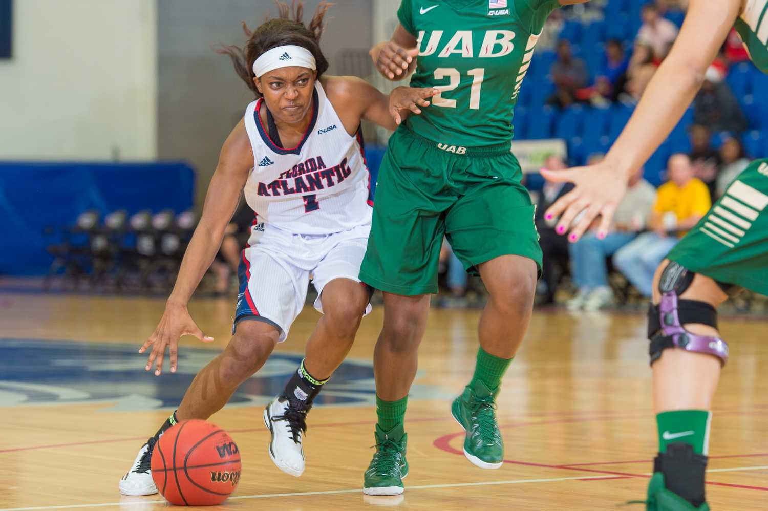 Owl's guard, Aaliyah Dotson (1) dribbles around UAB guard Chelsee Black (21) in the second half.  Dotson shot for five points on Thursday night.