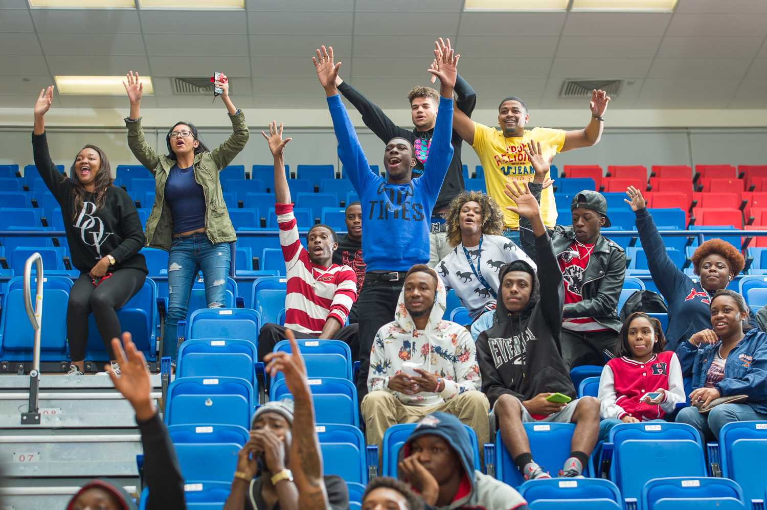 FAU students scream for t-shirts during a pause in play of FAU Women's Basketballs matchup against UAB.