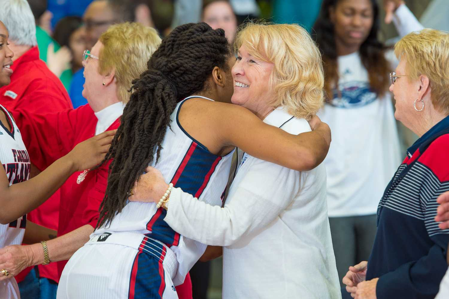 Shaneese Bailey (2) gives former FAU president Mary-Jane Saunders a hug after the Owl's ten point victory against UAB (66-56).
