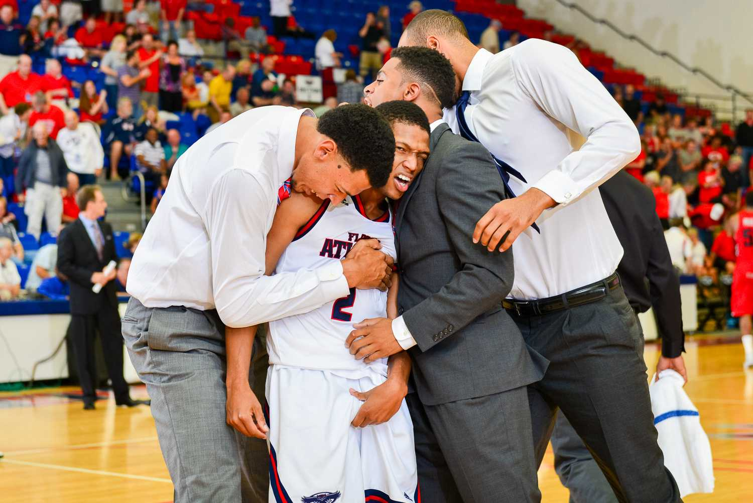 Botley (2) is embraced by his teammates after hitting a floater that forced overtime against Western Kentucky.