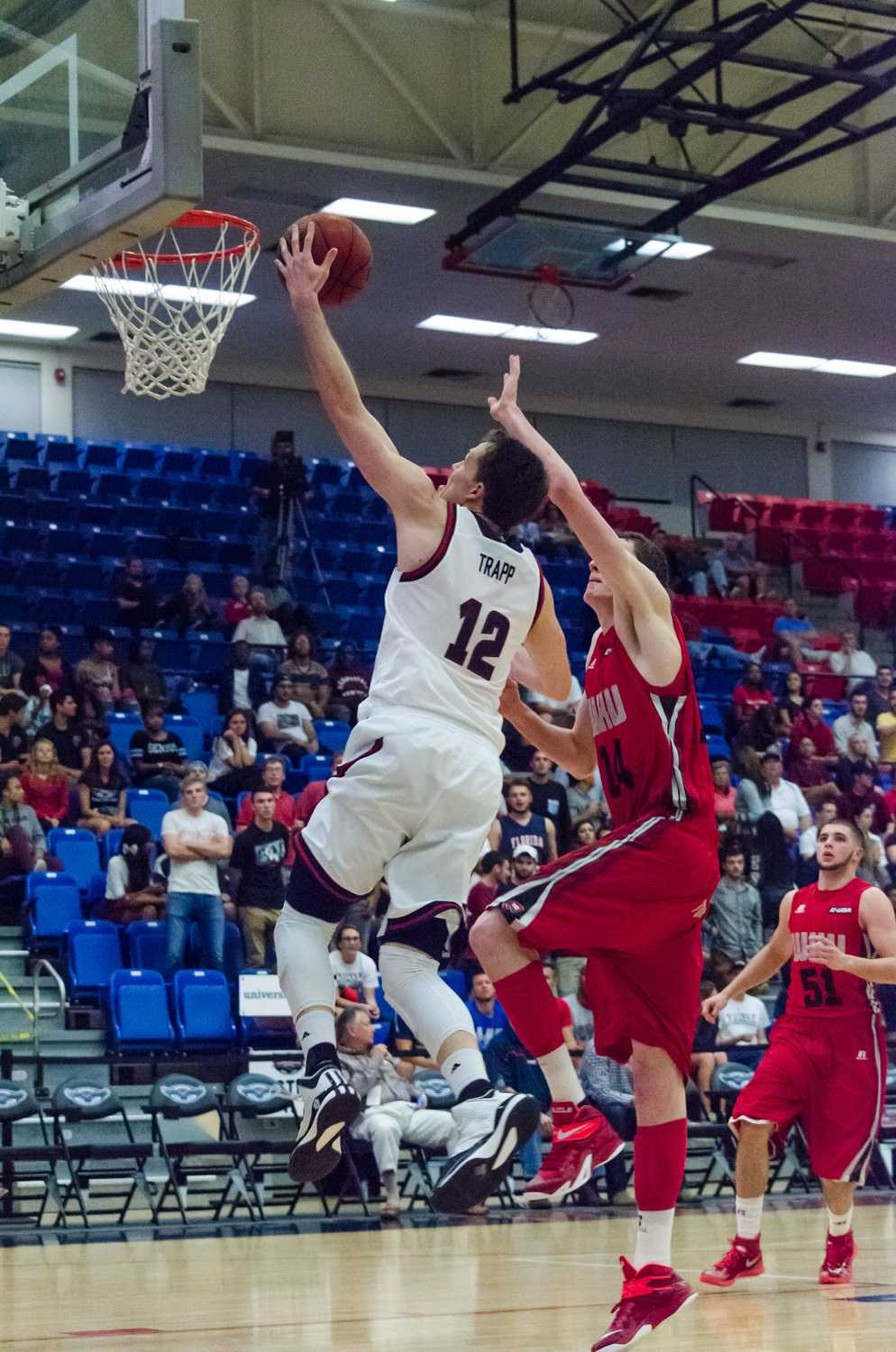 FAU guard Jackson Trapp (12) beats the WKU defense to the basket and uses of the glass to score.