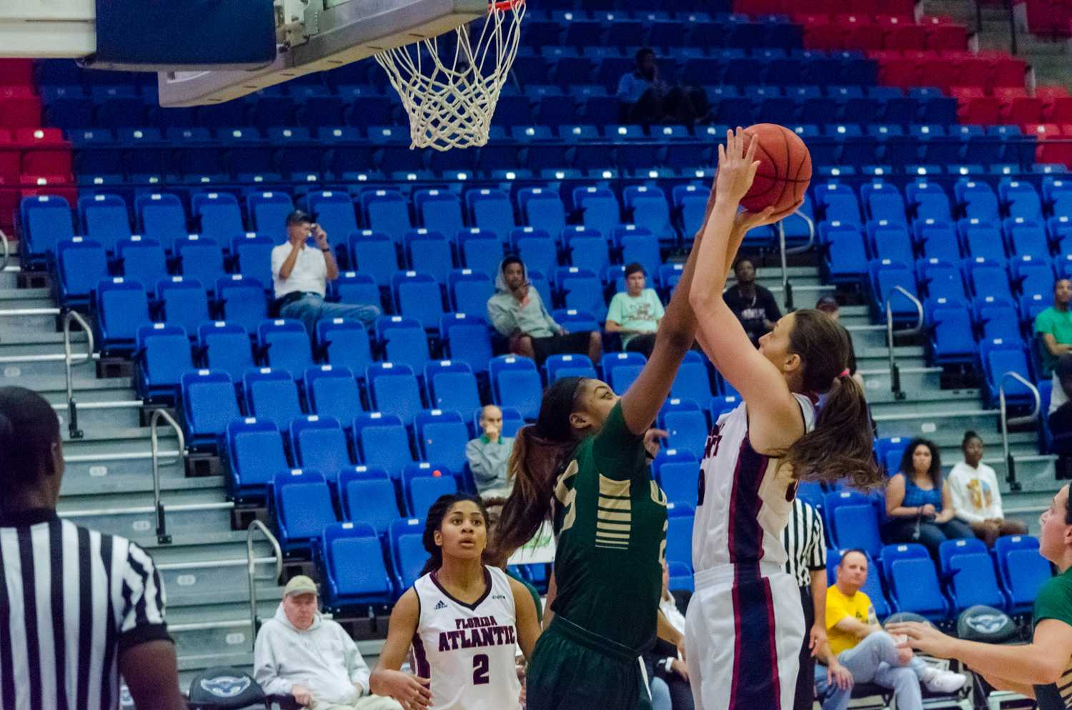Owl's forward, Melinda Myers (50) gets in low under the basket for an attempt to score.