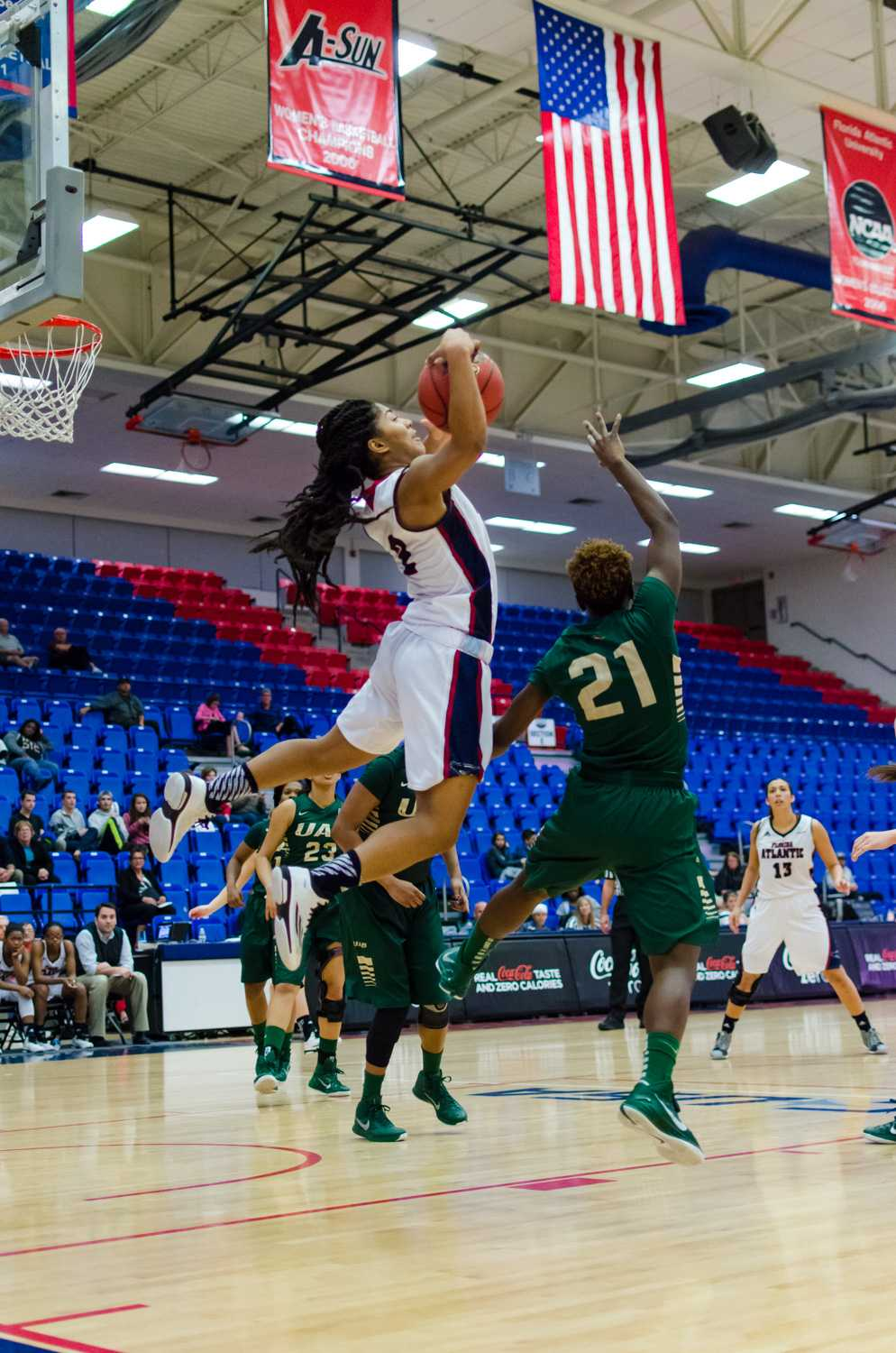 FAU guard, Shaneese Bailey (2) jumps up to catch a lobbed pass to her down low.
