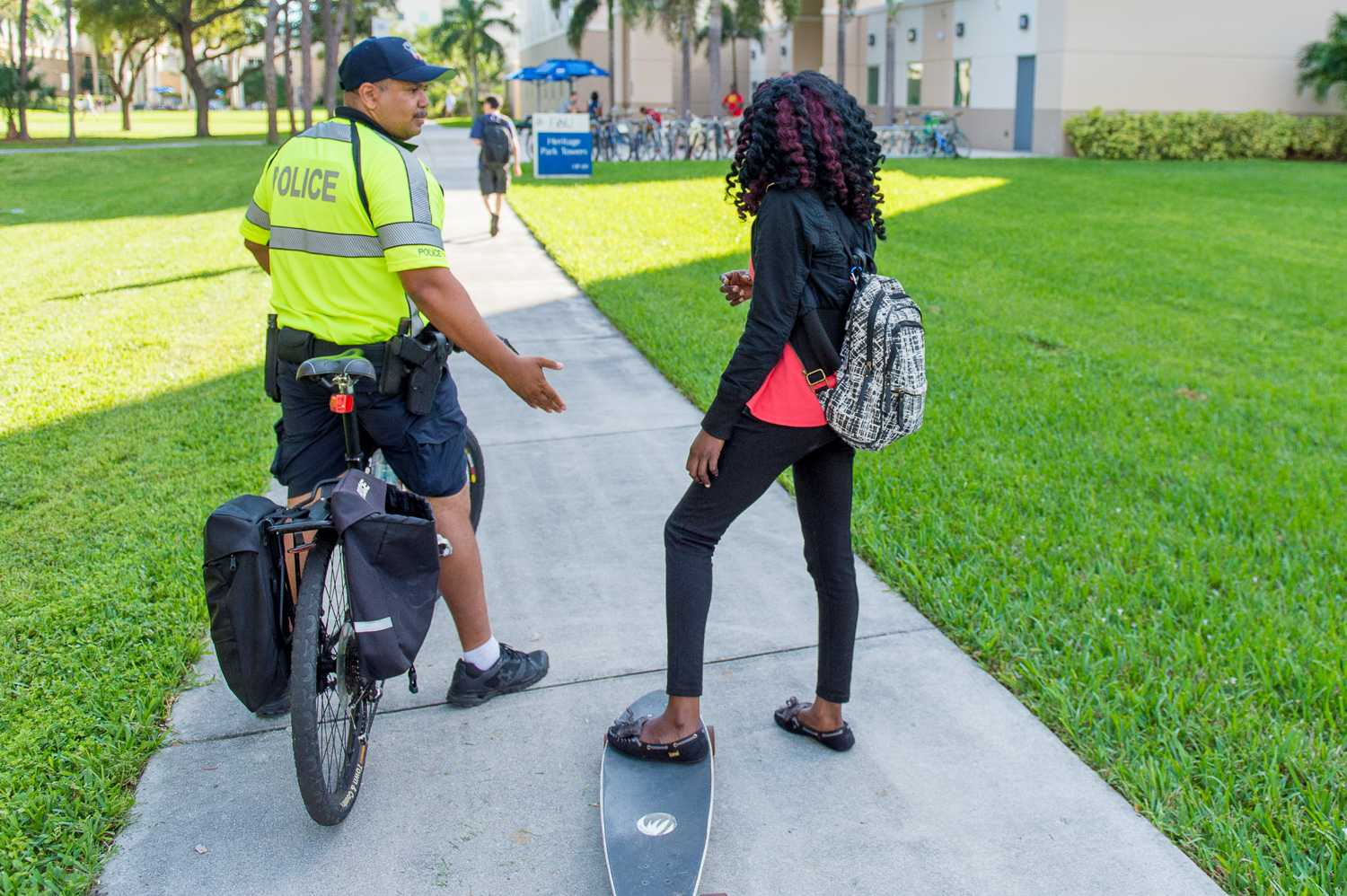 An officer of the FAU PD stops a student who would not get off of her longboard while in the breezeway.