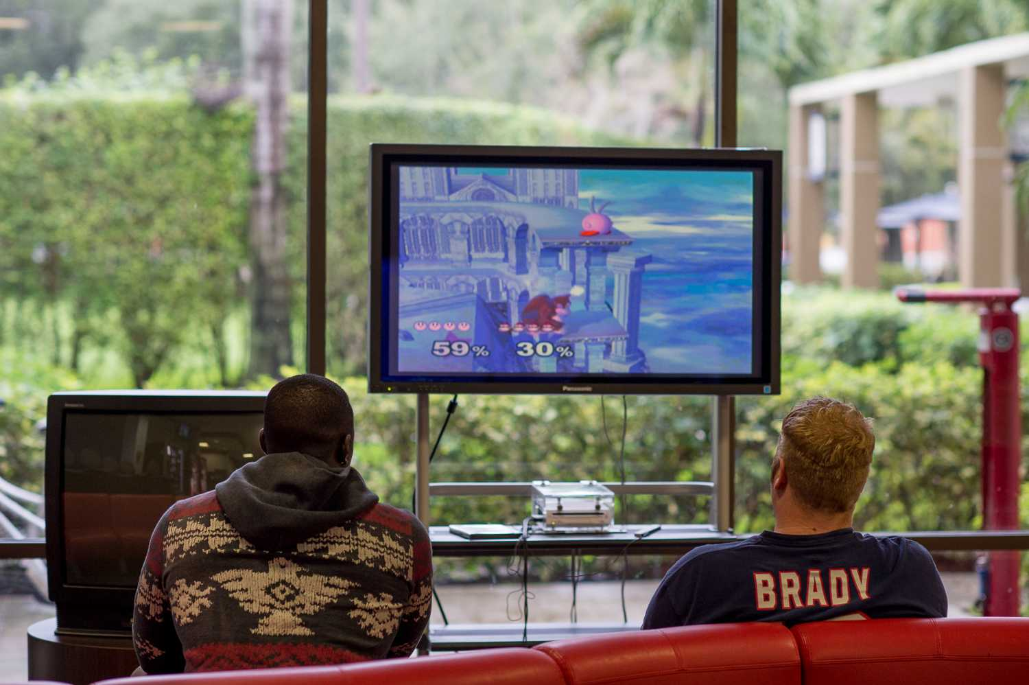 FAU Football players play Super Smash Brothers in the Boca Student Union on a rainy Sunday afternoon.