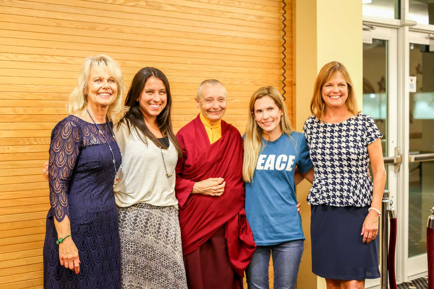 Jetsunma Tenzin Palmo and The Peaceful Mind Peaceful Life team pose for a photo after the lecture on Monday, Jan. 5 in the University Theater. Barb Schmidt (far left) is the founder of the program and her family recently donated $16 million to the athletics program - the biggest donation in FAU history. Kiki Baxter | Contributing Photographer