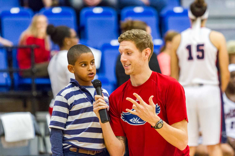 FAU radio personality Aaron Shapiro speaks to a small child.