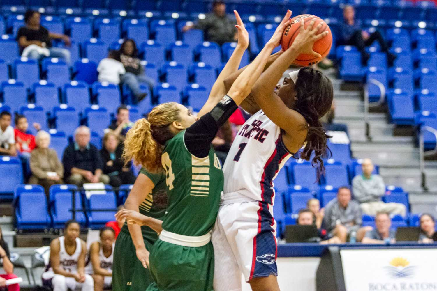 FAU point guard Aaliyah Dotson shoots a contested shot over an UAB defender.
